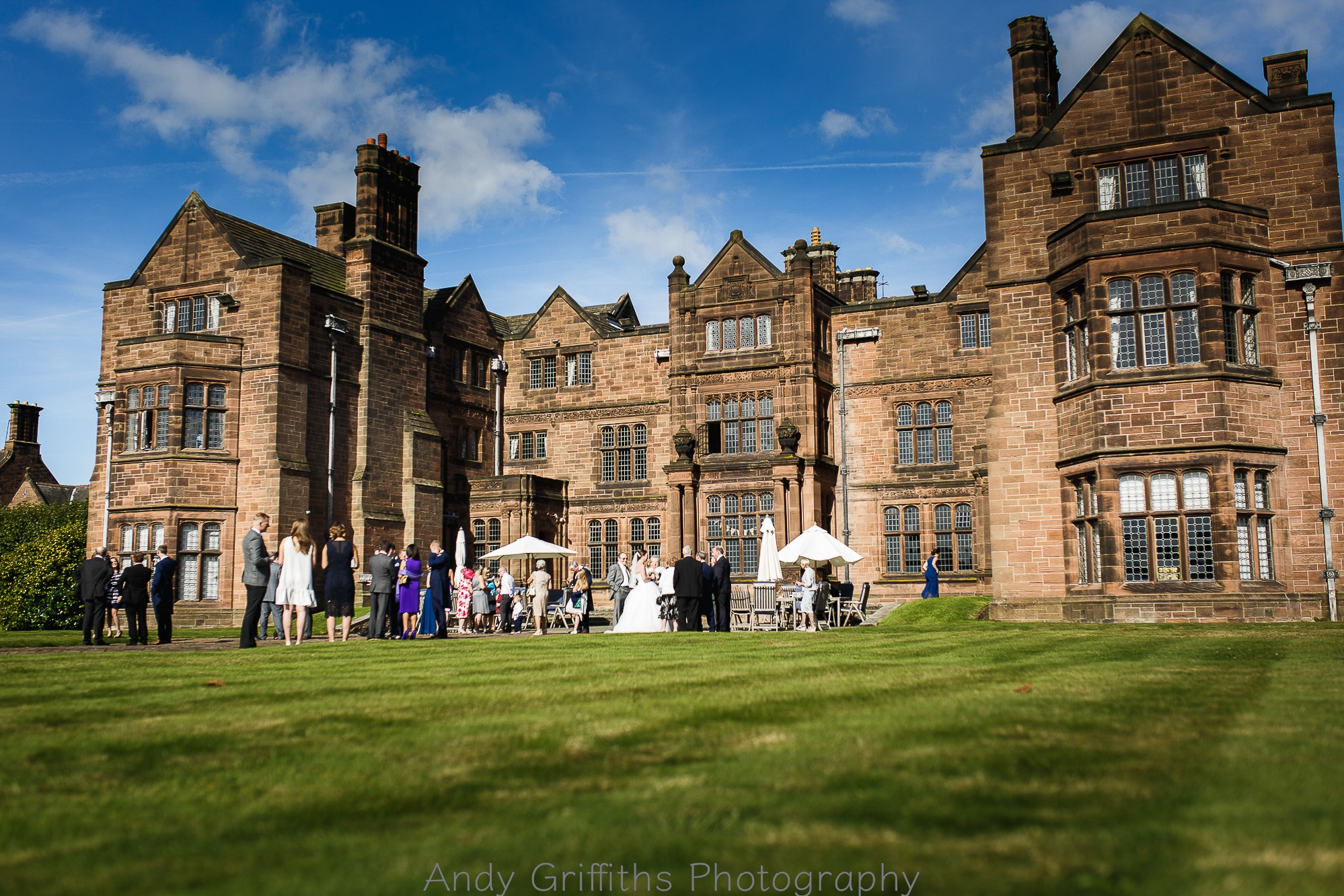 Thornton Manor in the sun with guests enjoying a reception drink