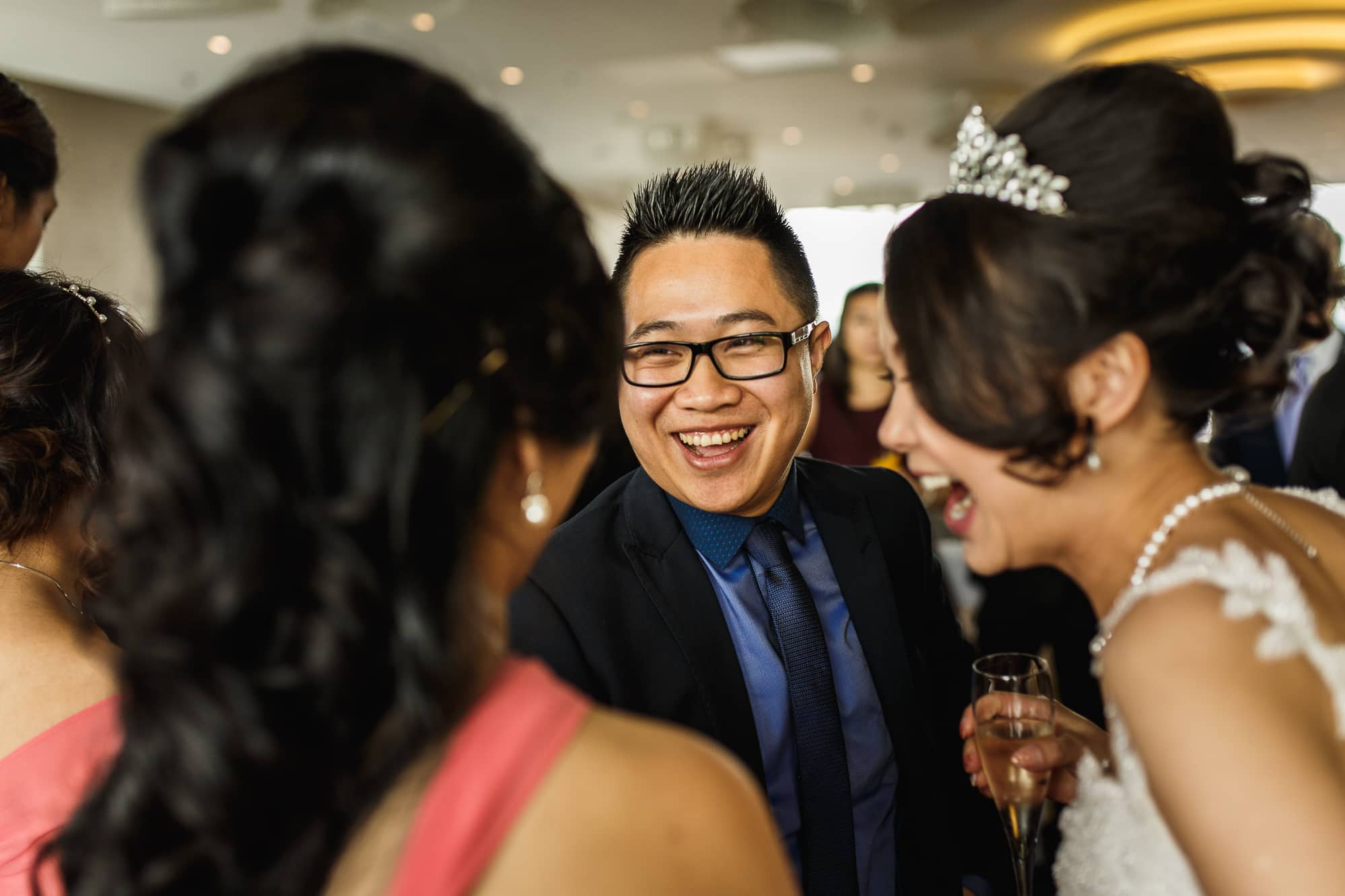 Bride laughing with guests at Cloud 23