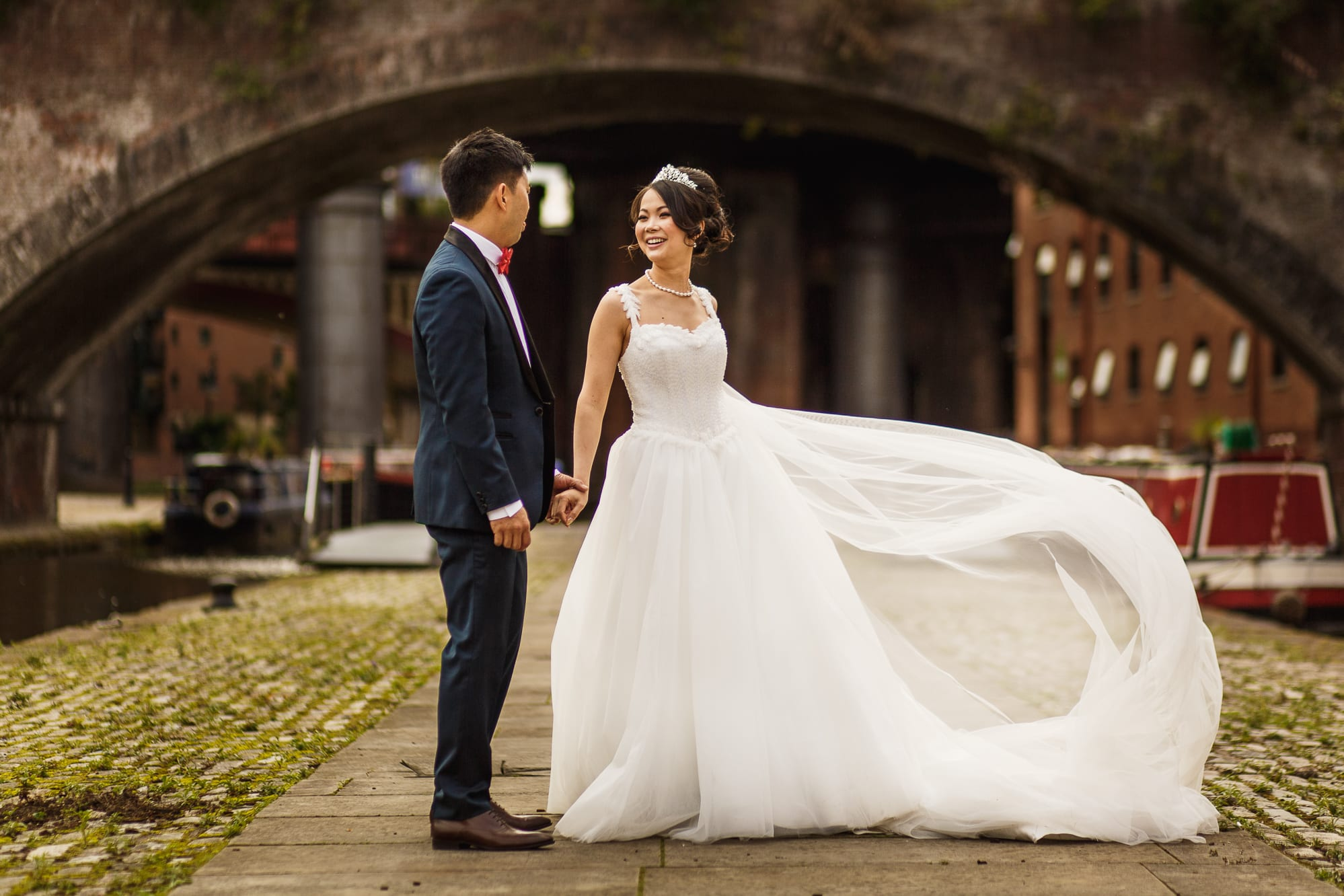 Bride and groom with lovely dress flowing in wind