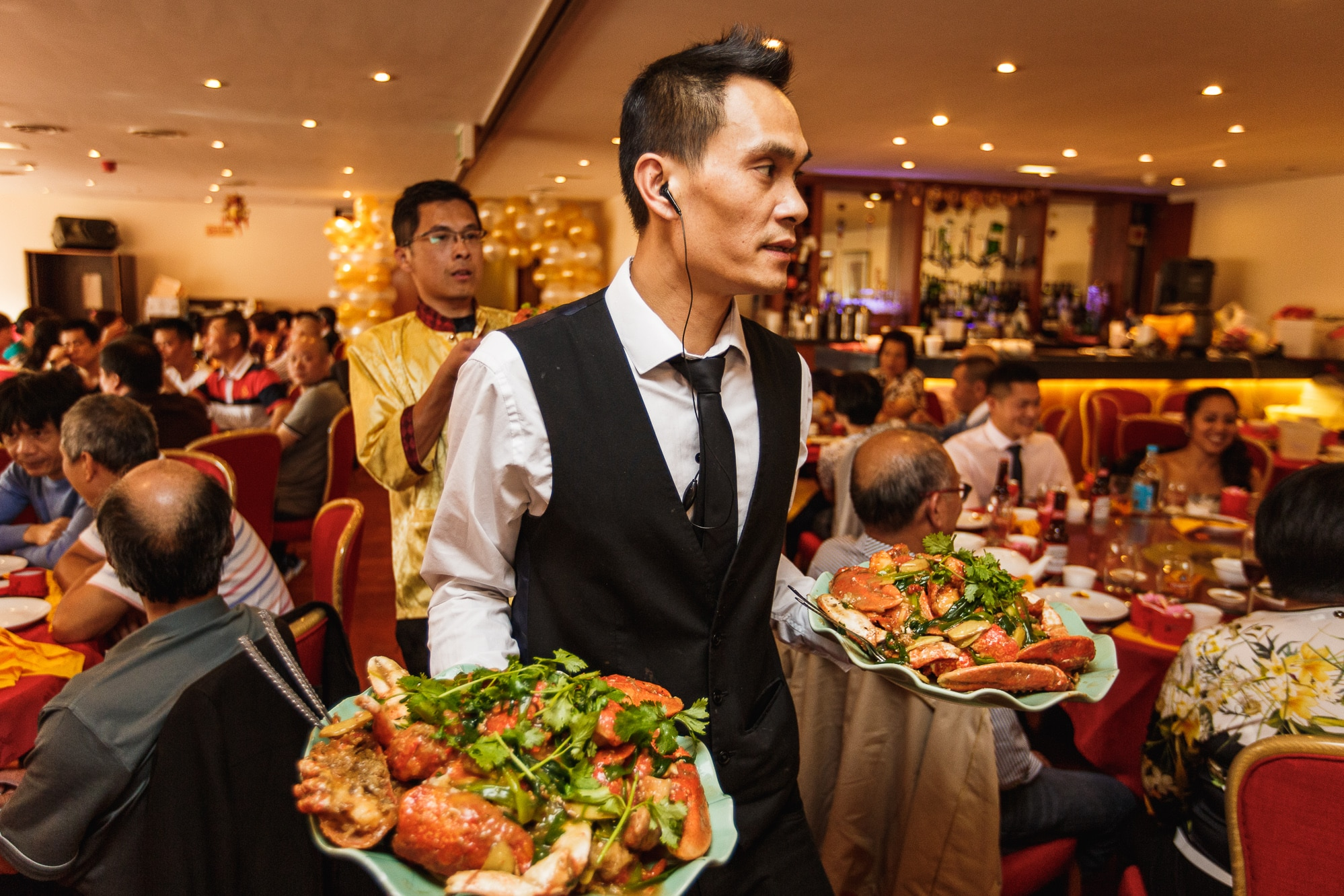 Waiter with Chinese banquet