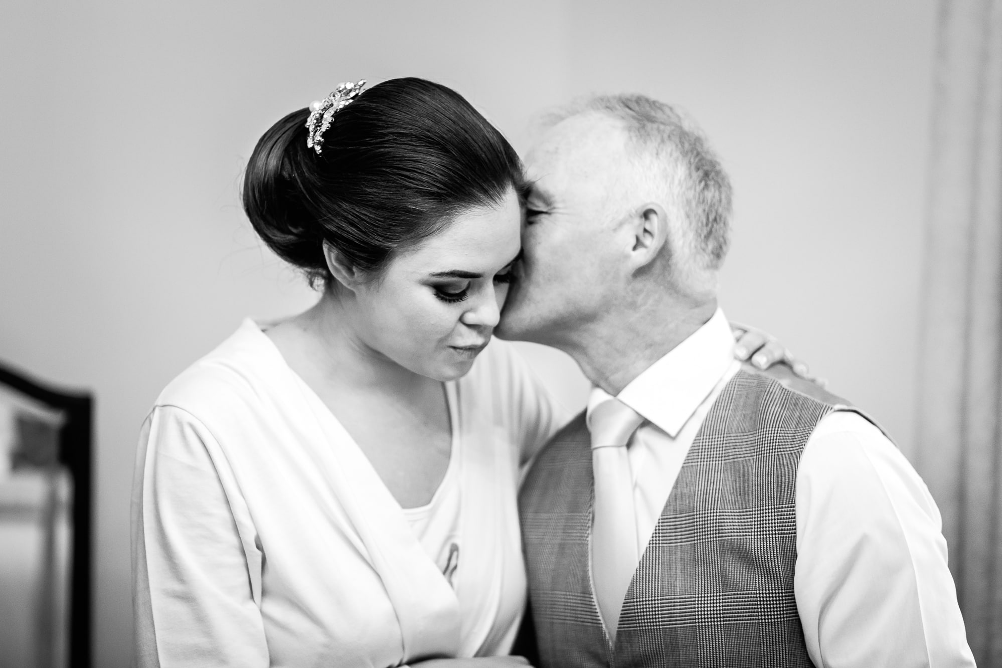 dad kissing bride