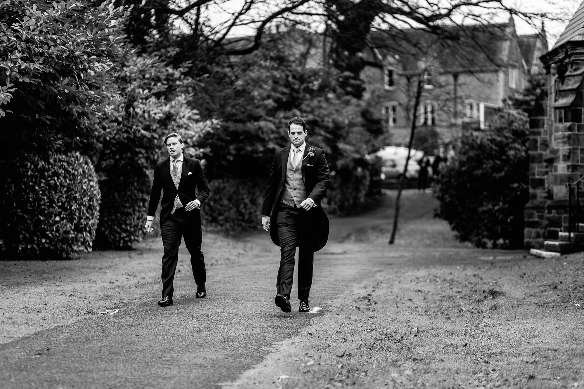 groomsmen walking down church grounds