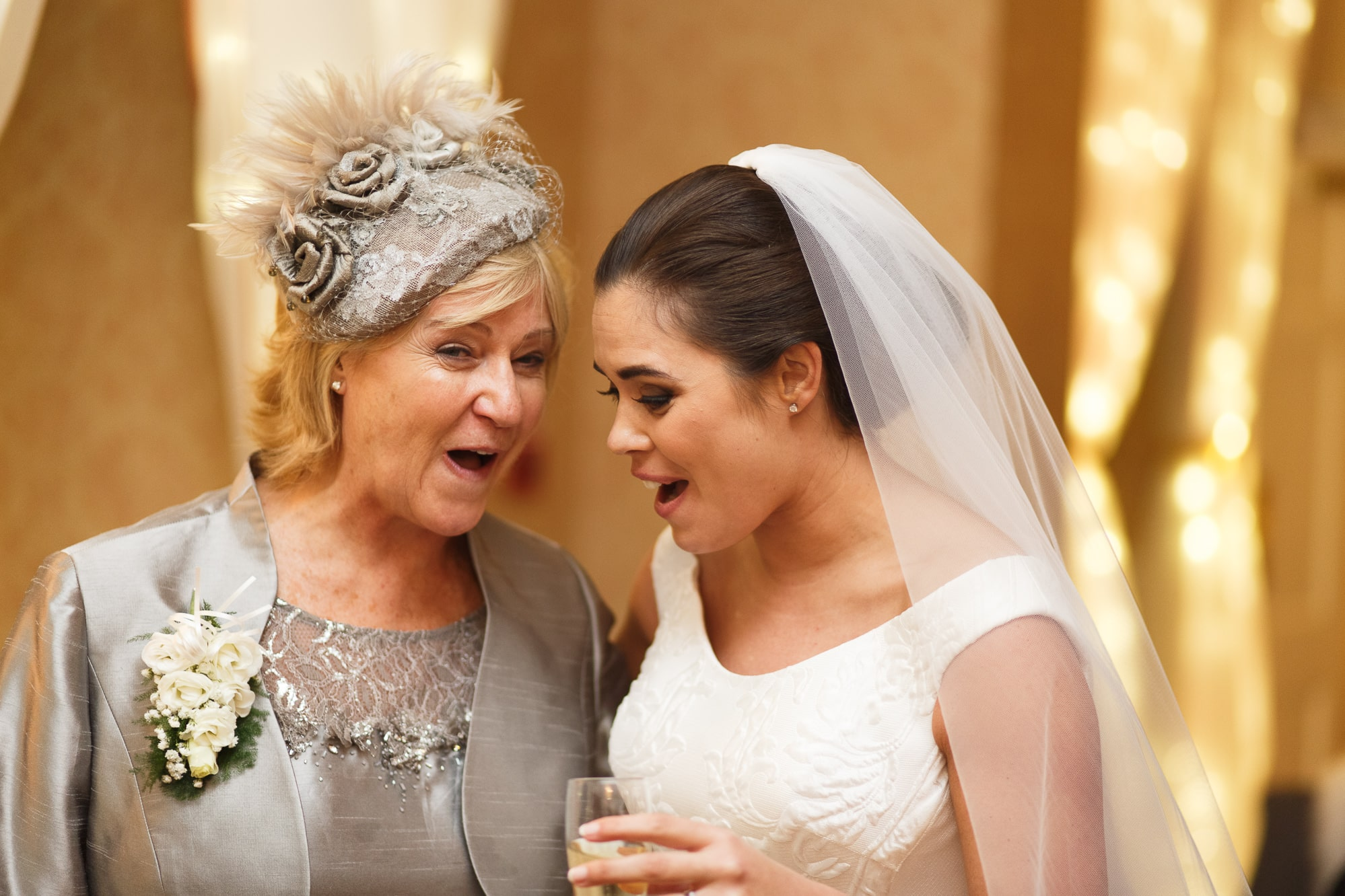 bride and mother in law laughing