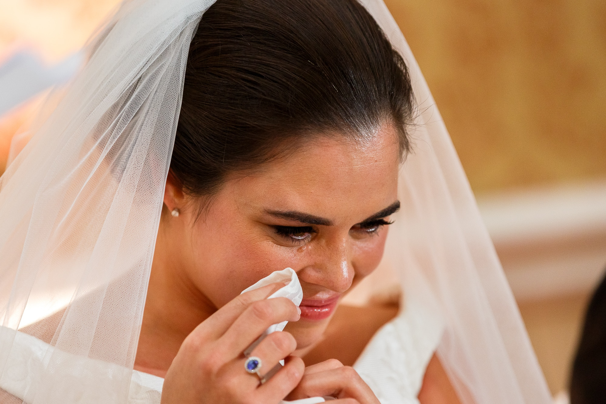close up of bride crying