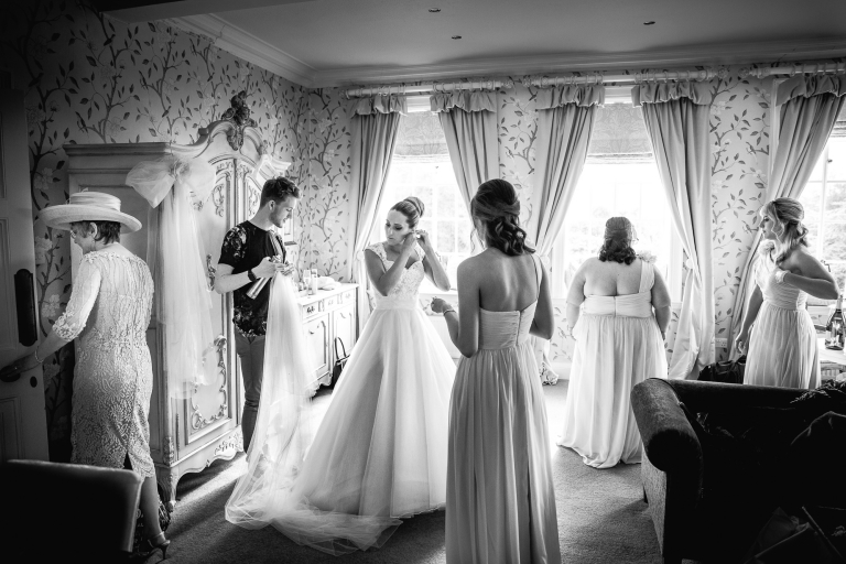 bride getting ready with everyone at Eaves Hall