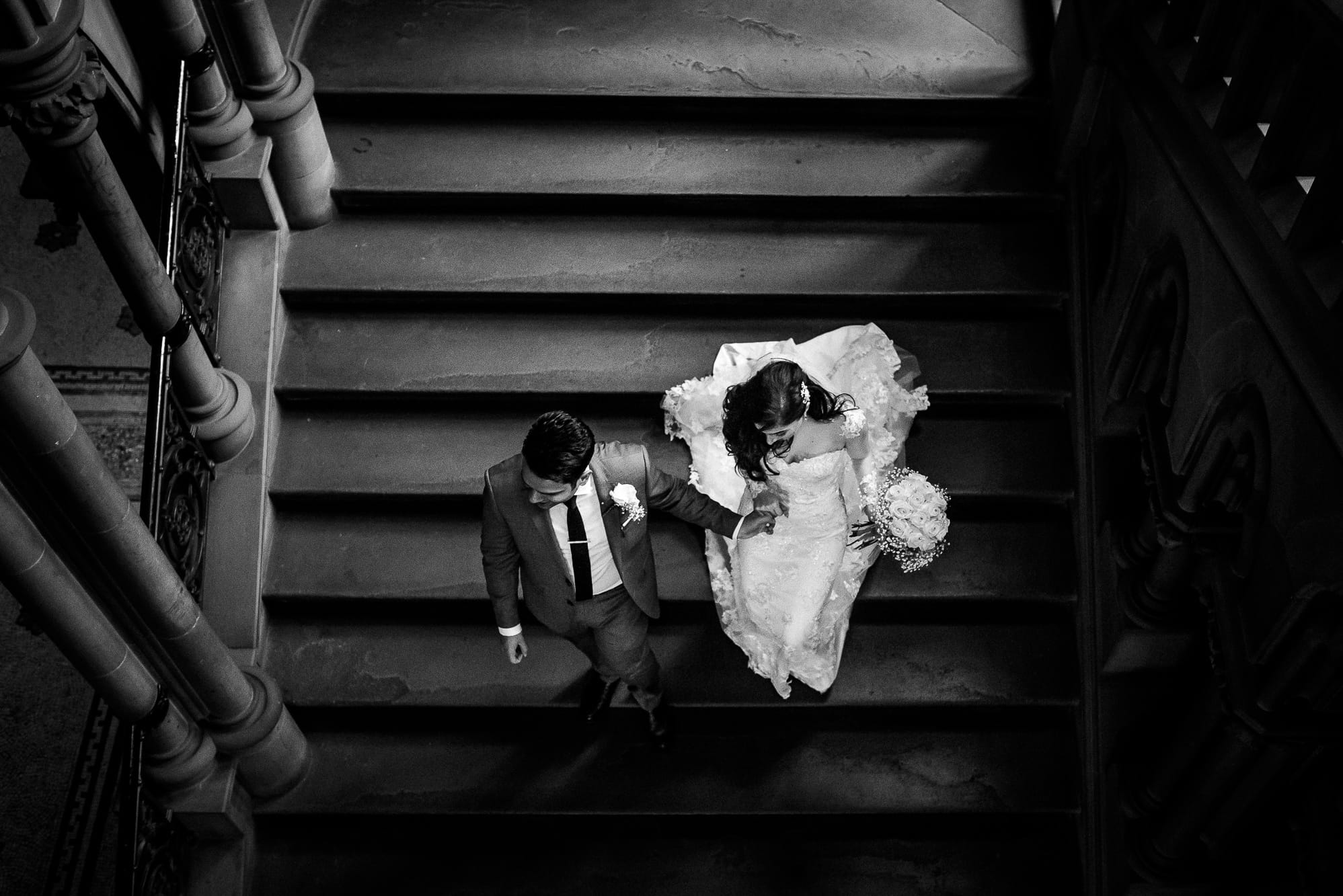 bride and Groom walking down stairs at Manchester Townhall