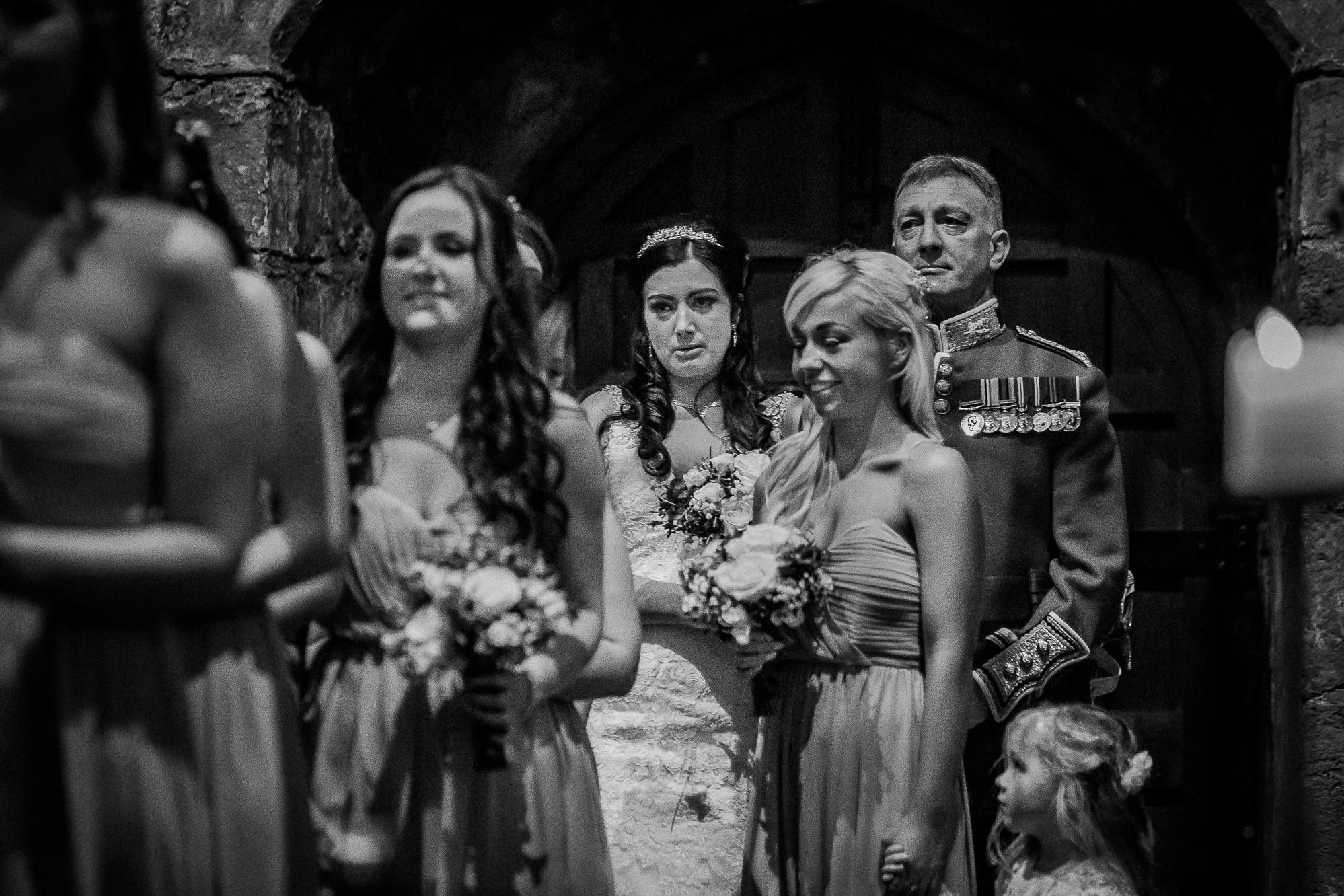 bride crying as entering church