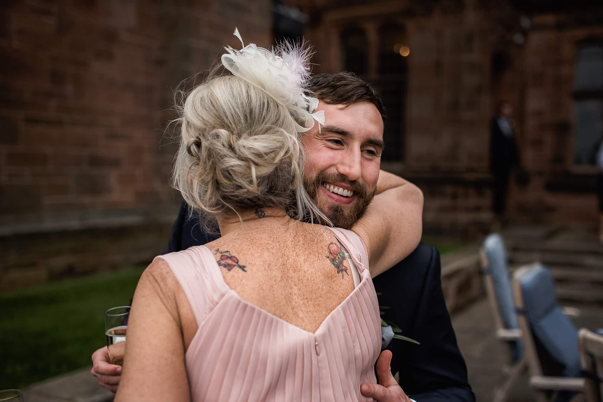 Groom hugging mum