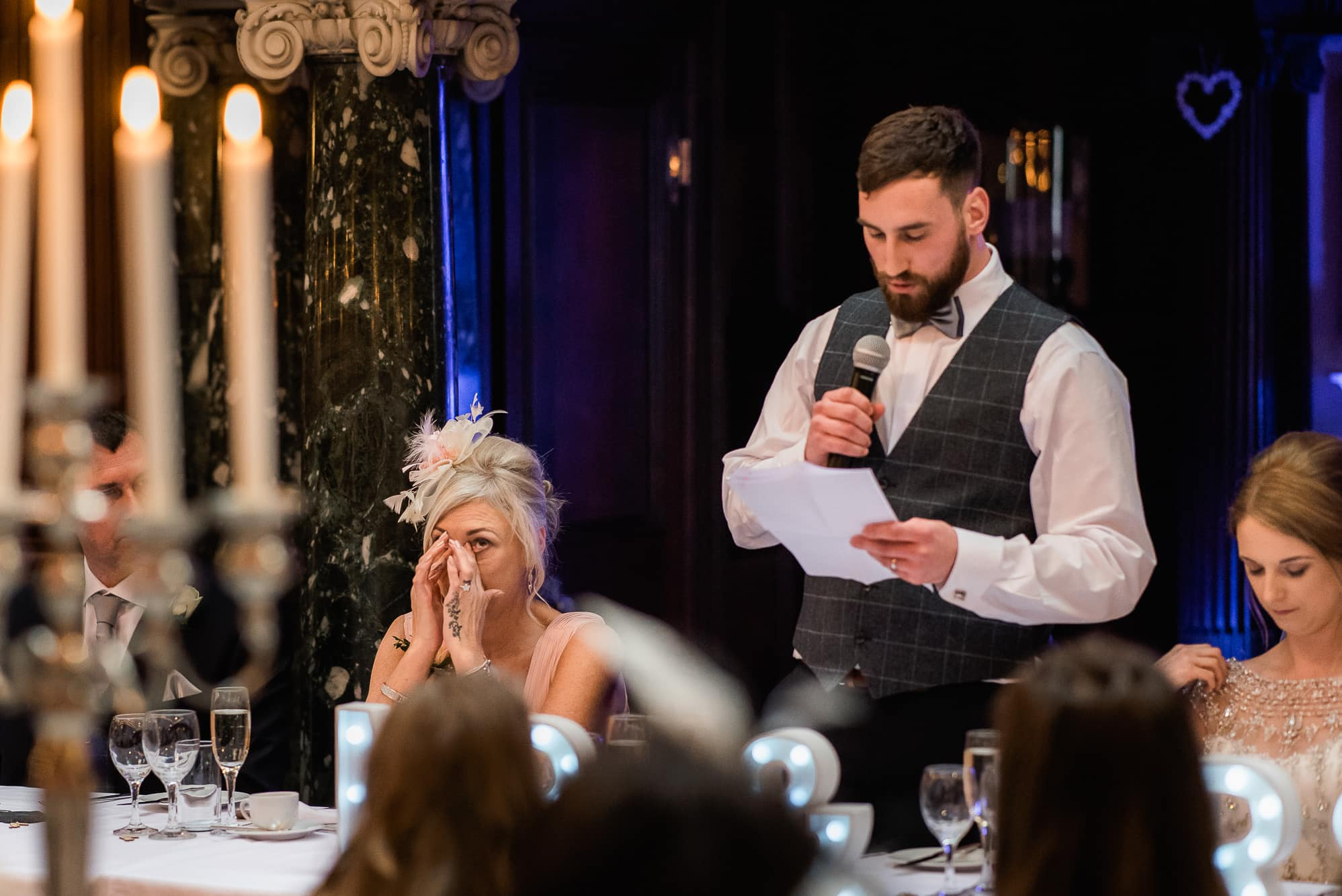 groom speaking and mother of bride crying
