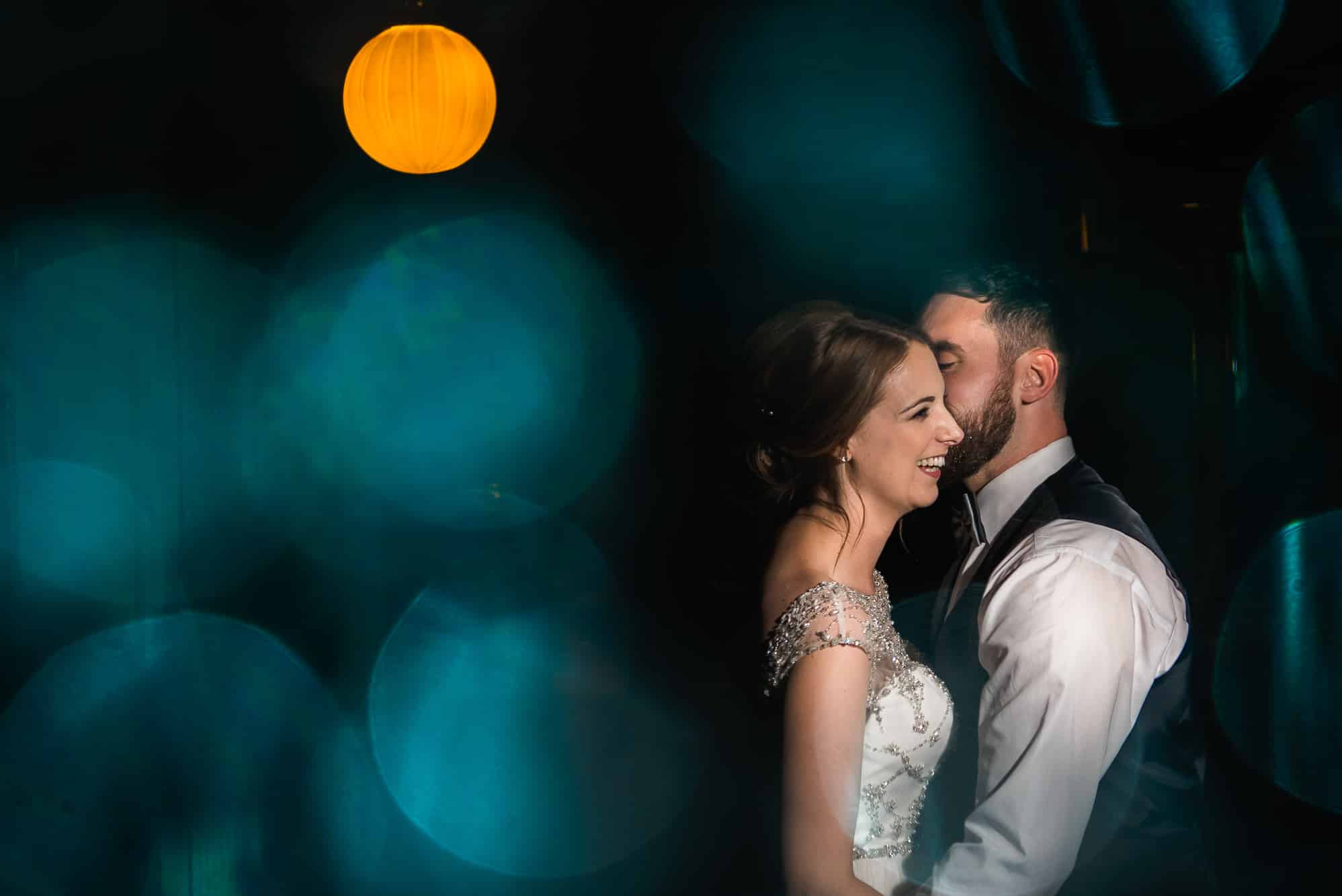 bokeh with bride and groom