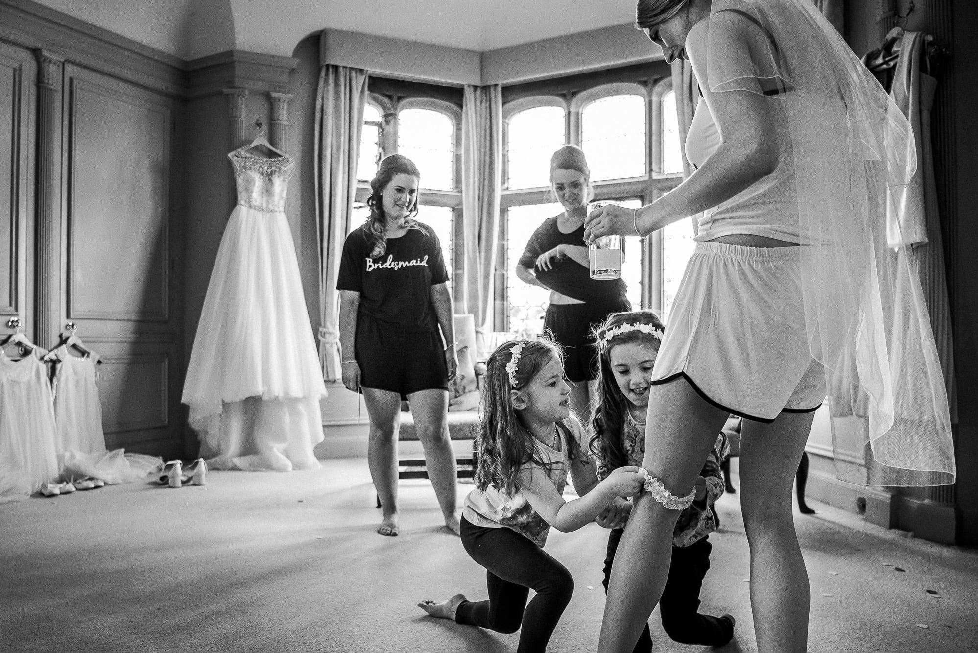 flowers girls helping bride get dressed