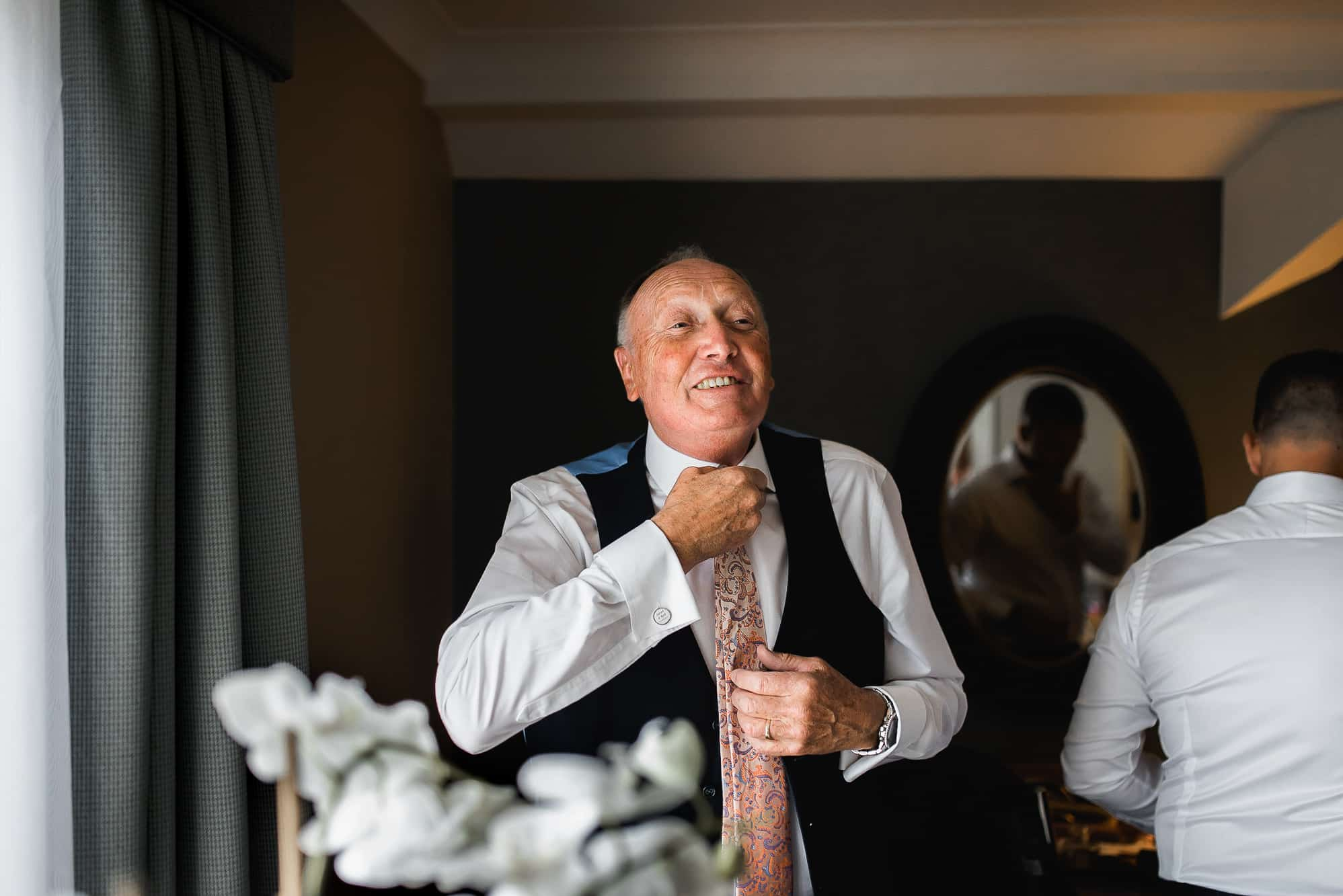 Grandad getting dressed into his suit