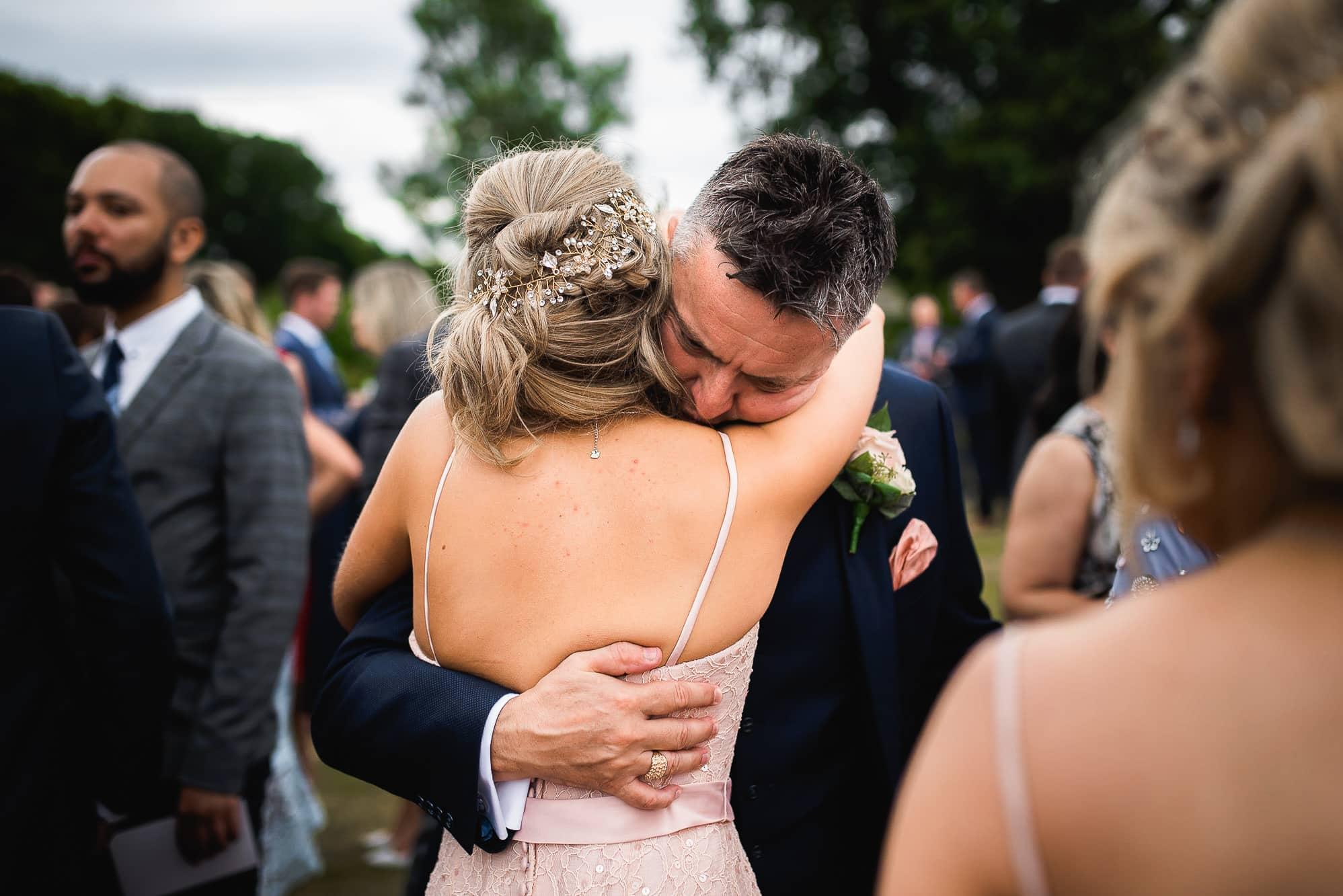 Dad hugging bridesmaid