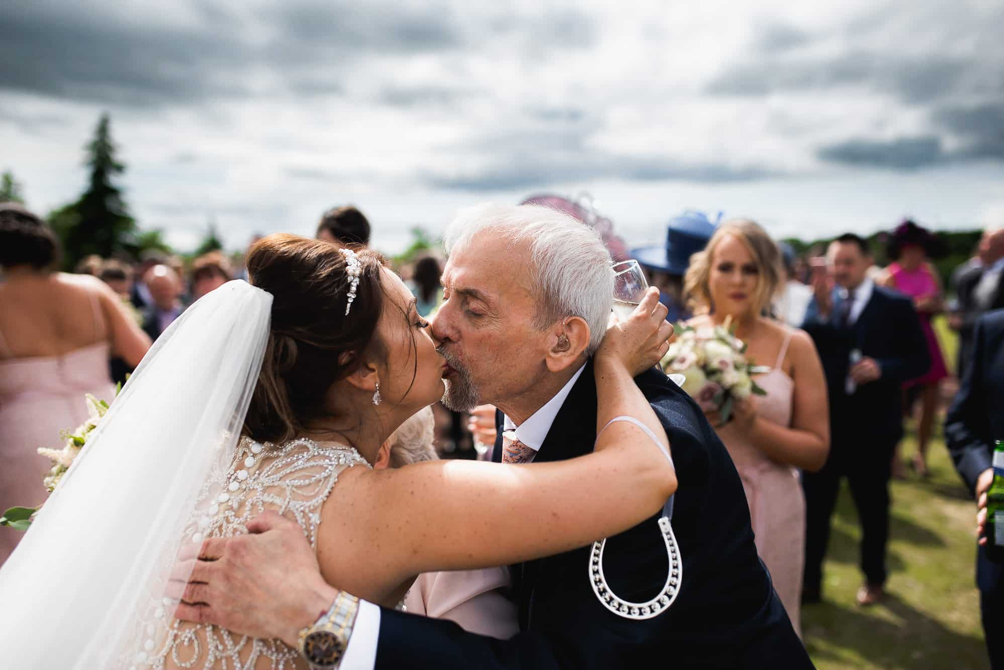 Bride kissing her grandad