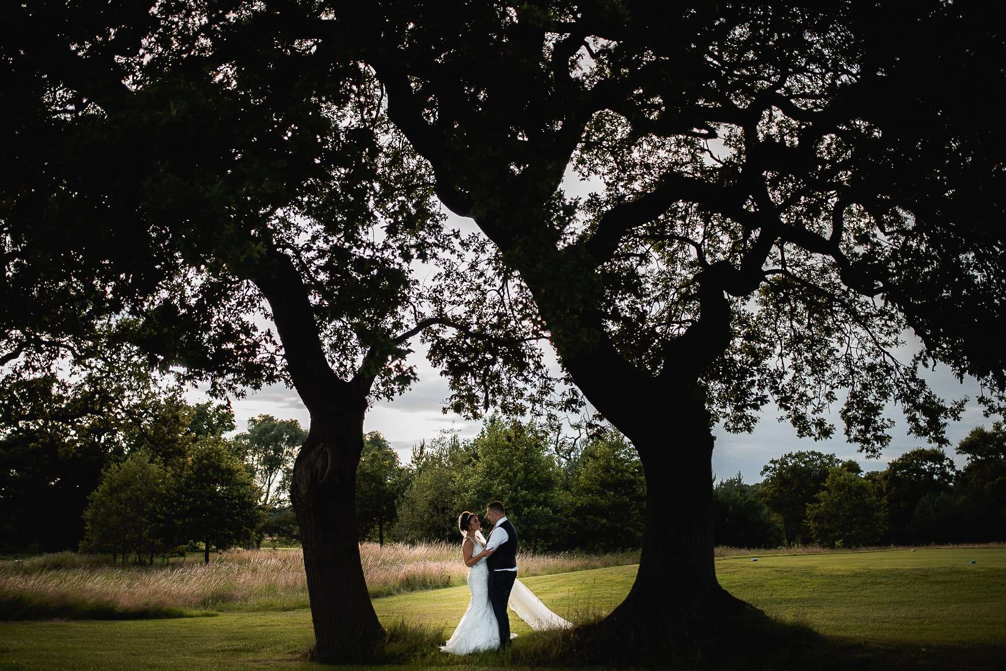 Bride and groom going for a walk in the trees