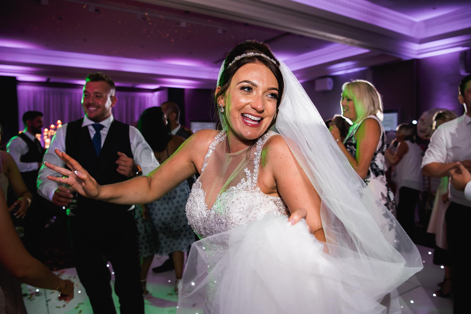 Bride dancing at Carden Park