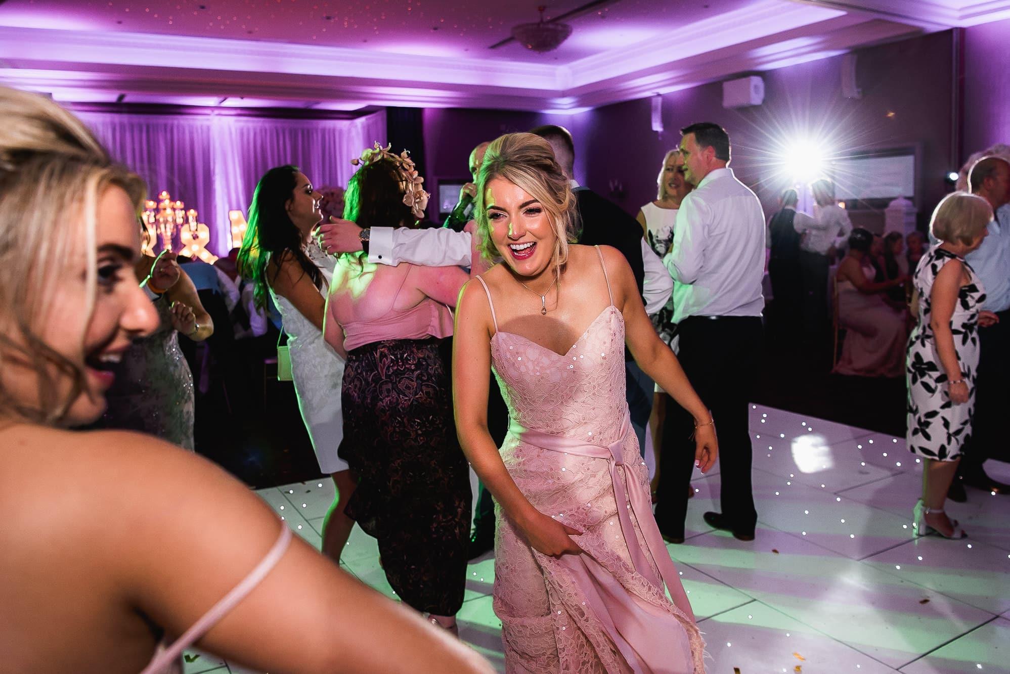 Bridesmaid dancing at Carden Park