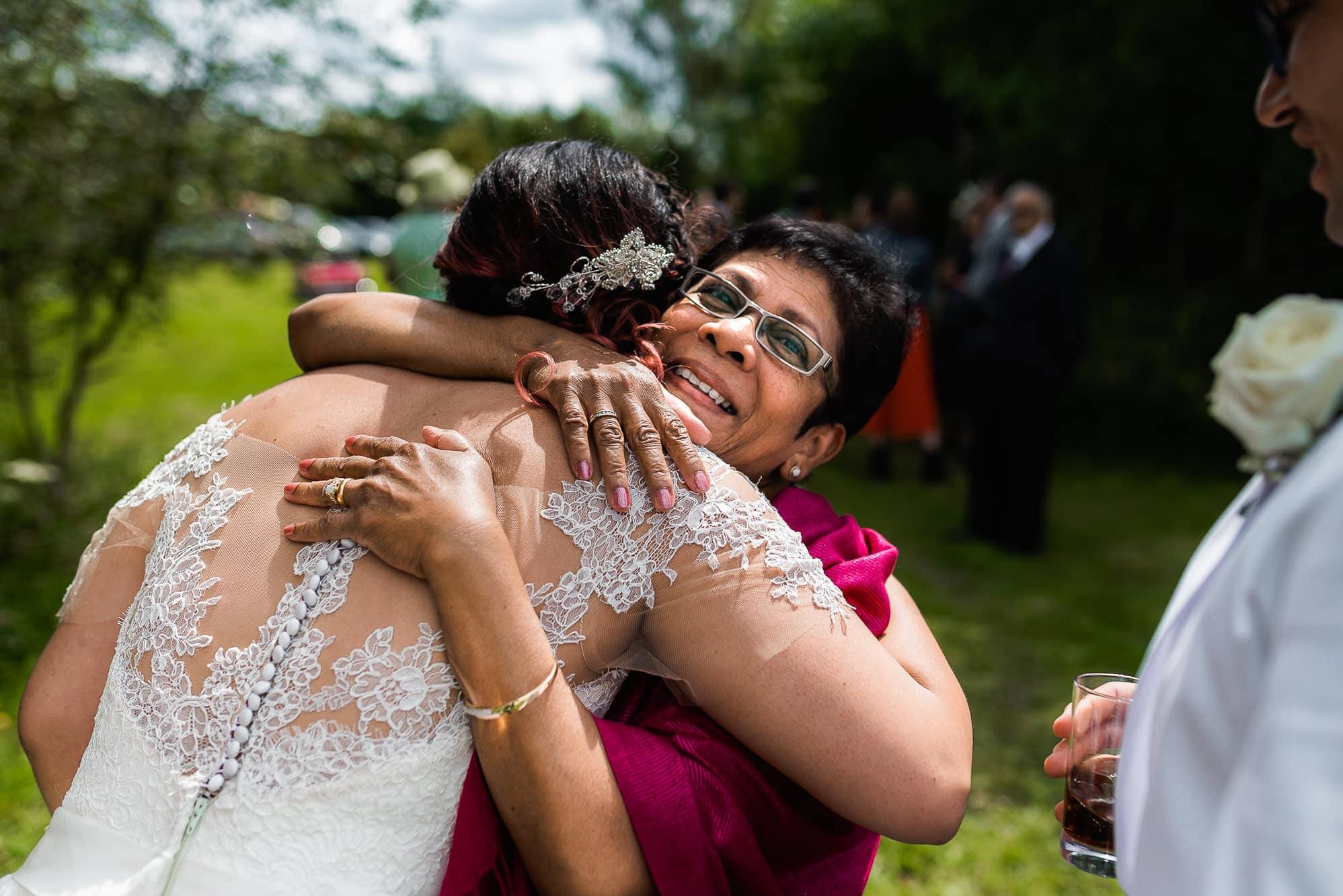 bride hugging her new aunty