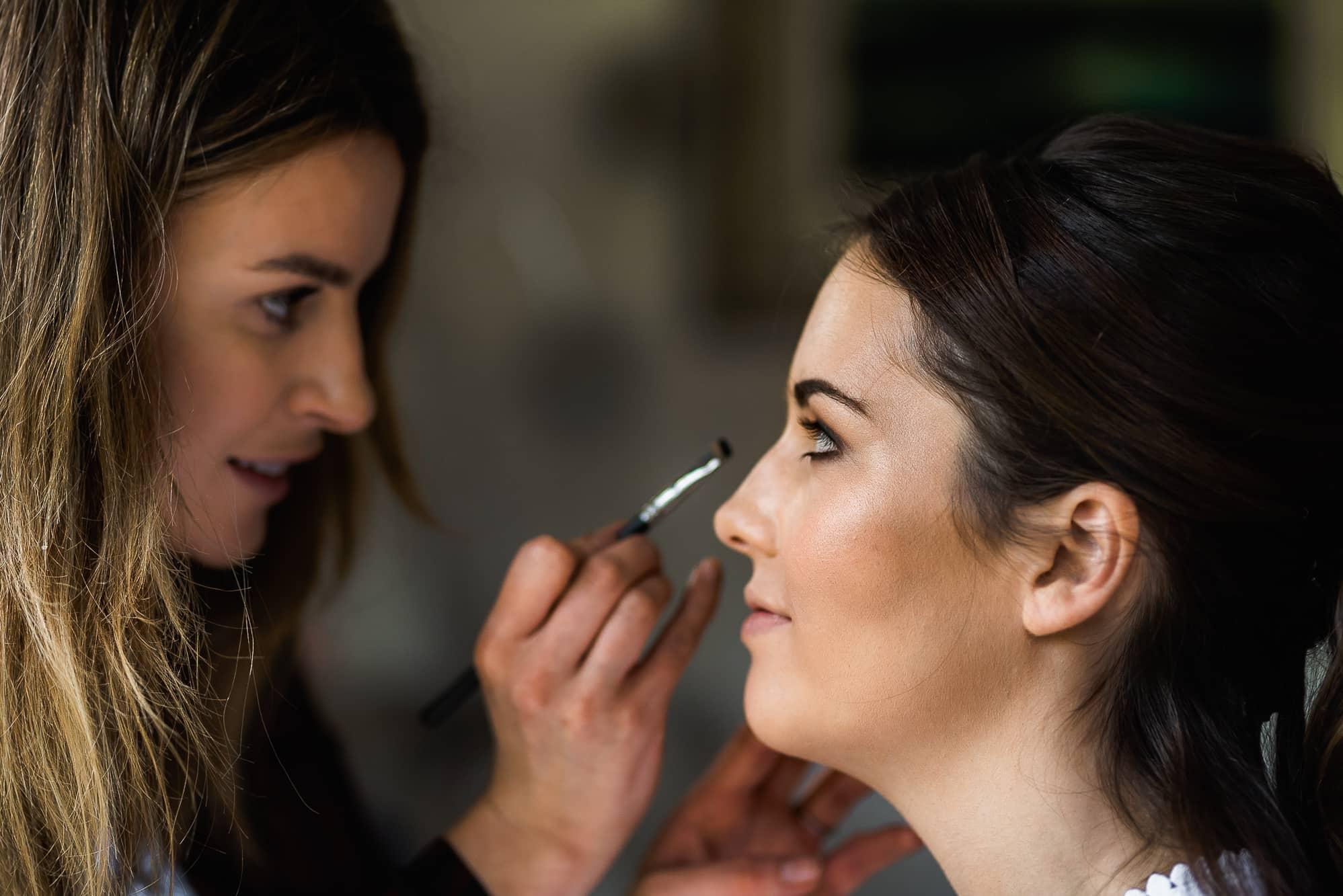 Claire Evans MUA doing brides make up