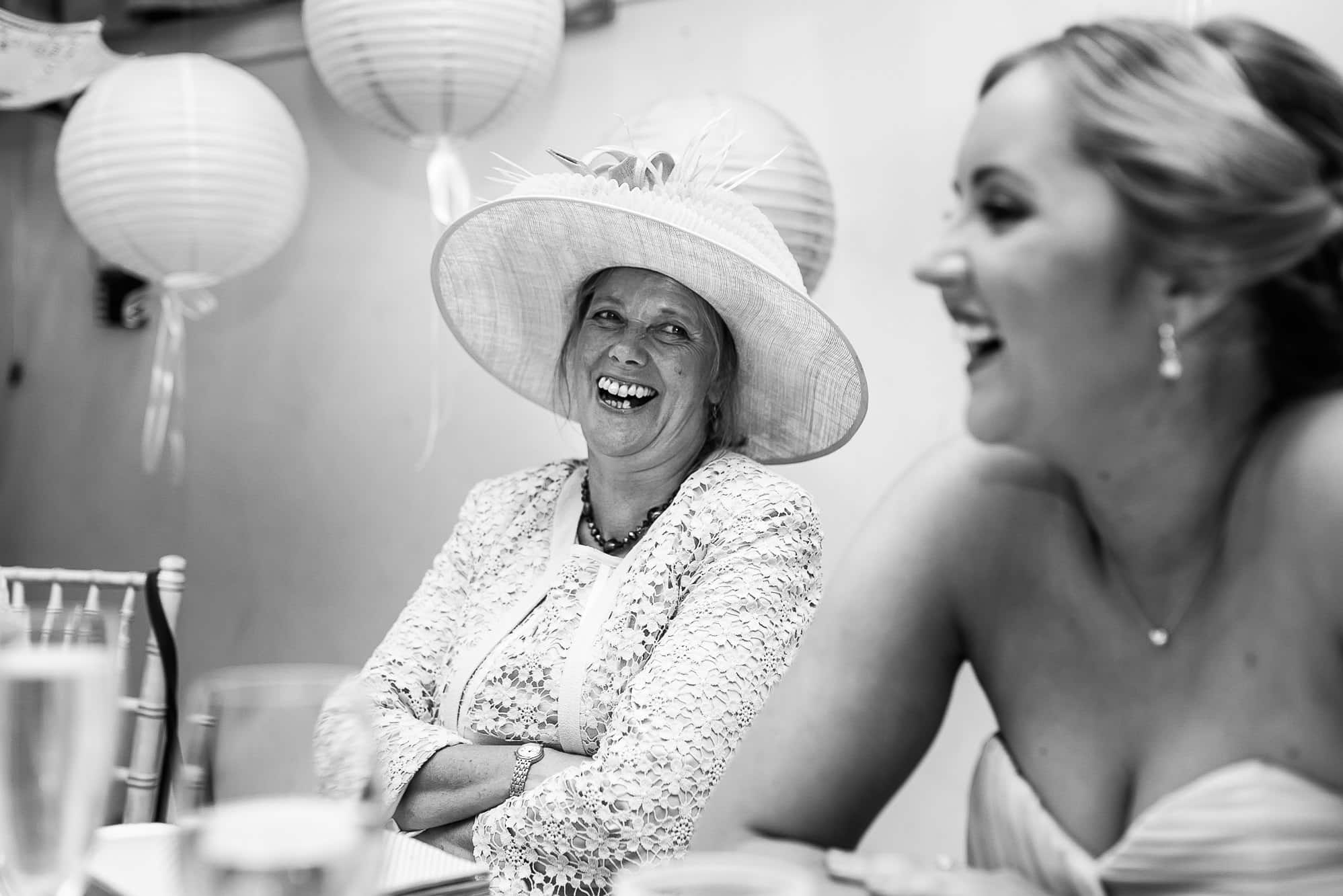 mother of groom laughing