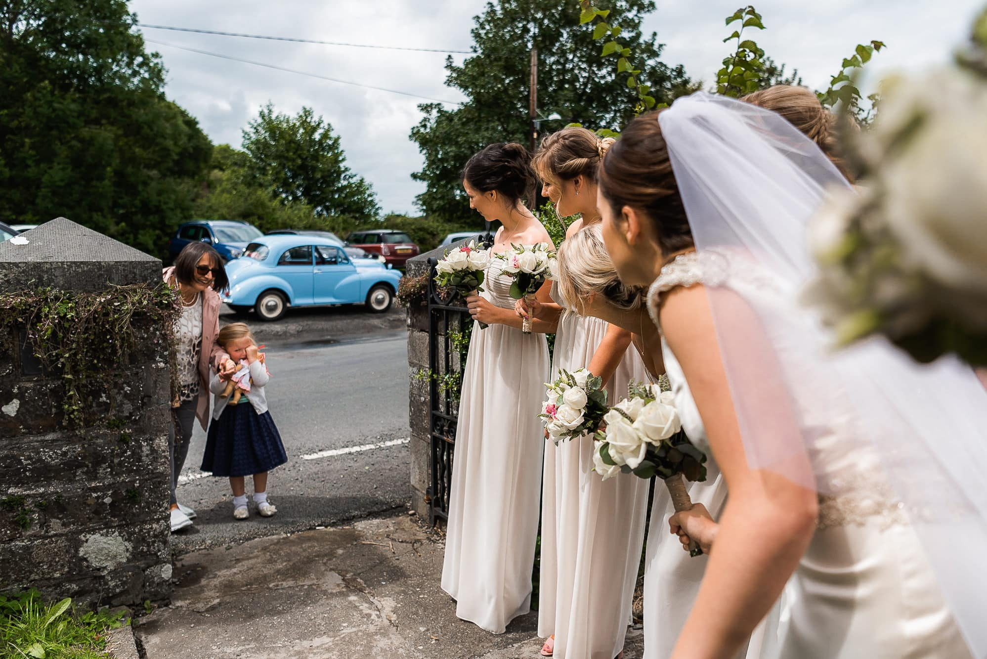bride talking to family friend outside church
