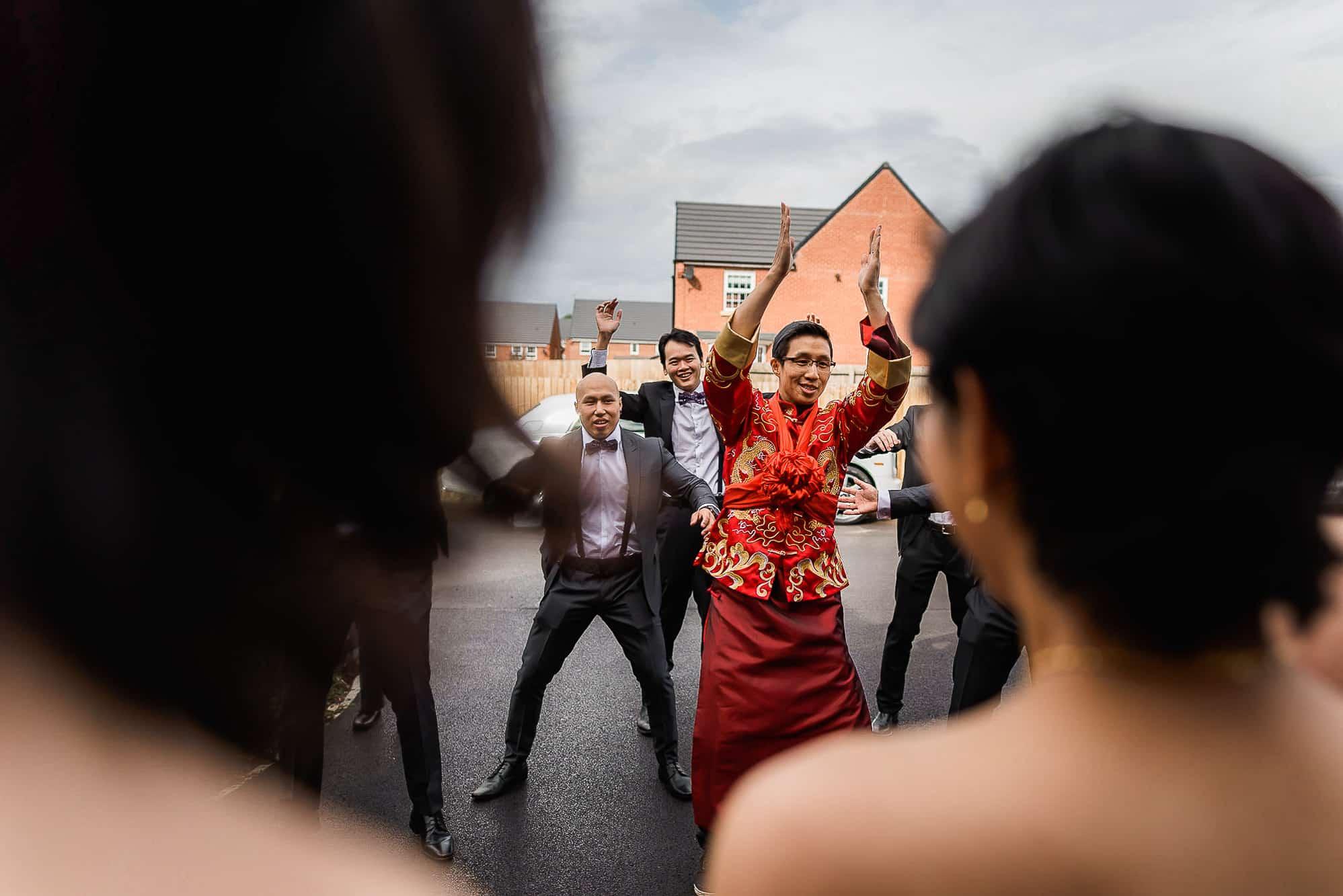 Groom dancing for Chinese door game