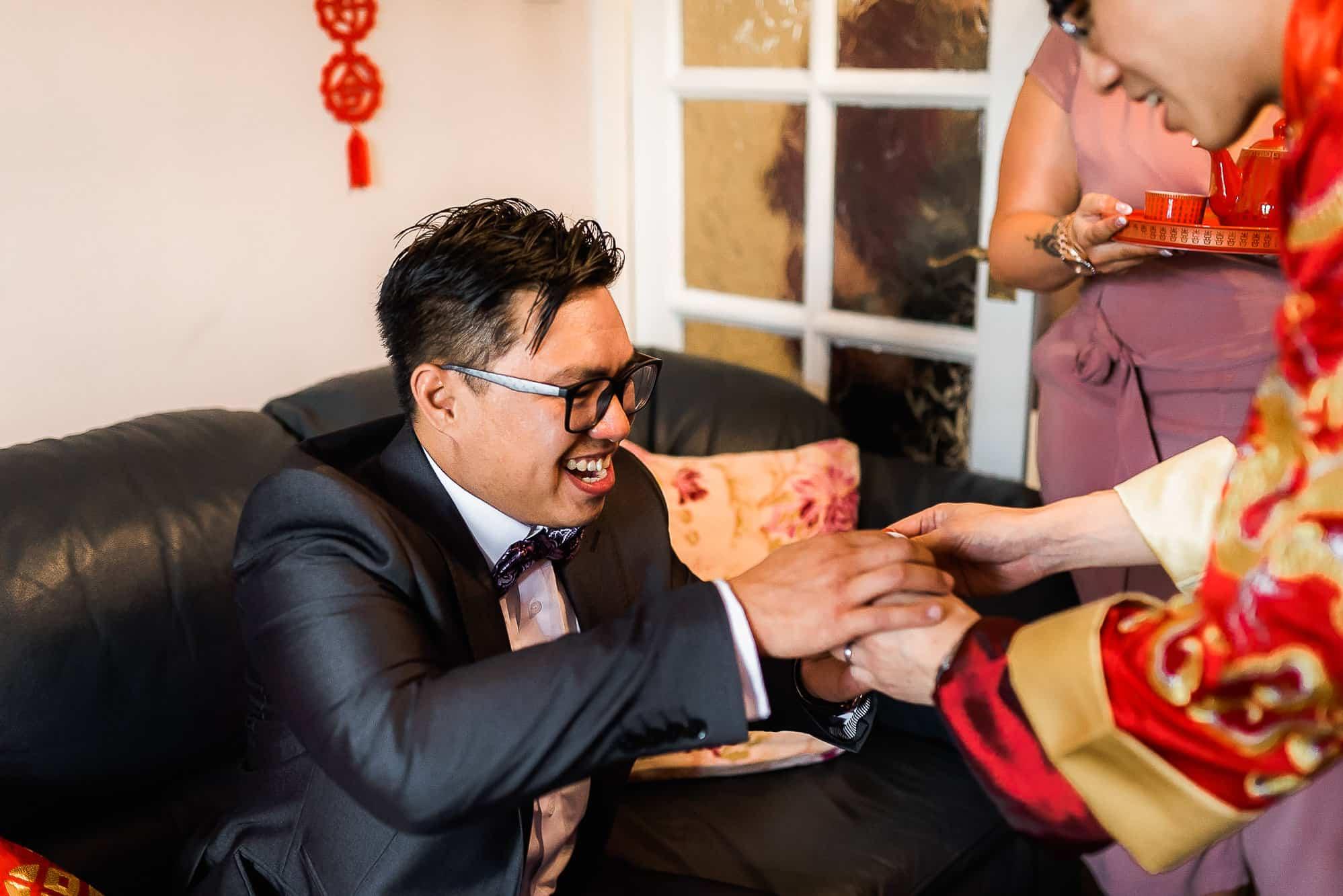 Groom having tea from groom