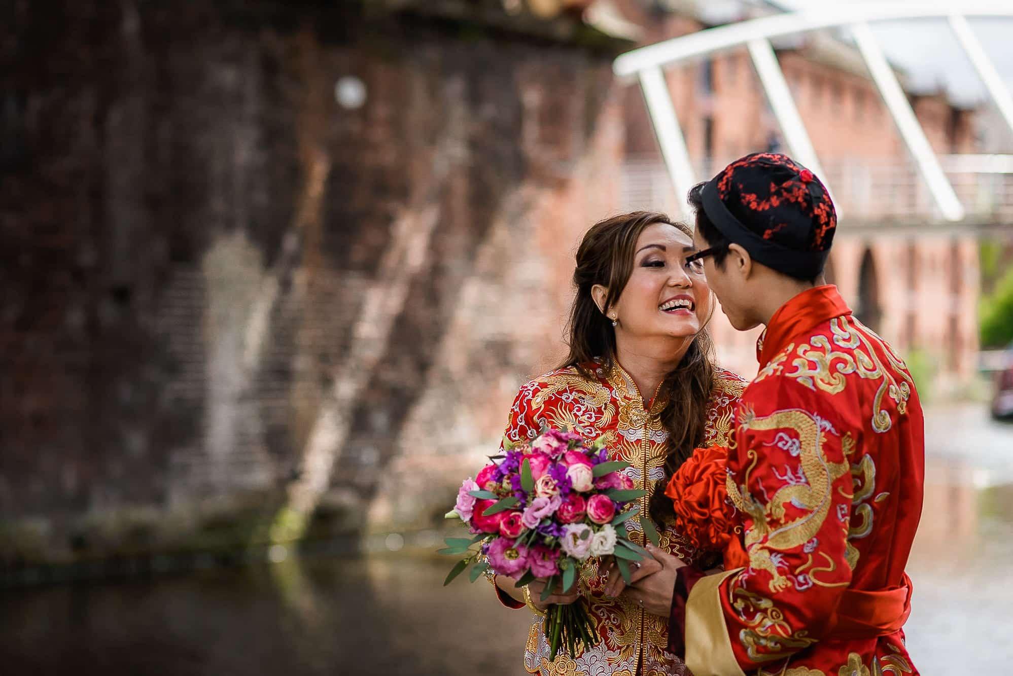 Bride and groom under a bridge at Castlefield