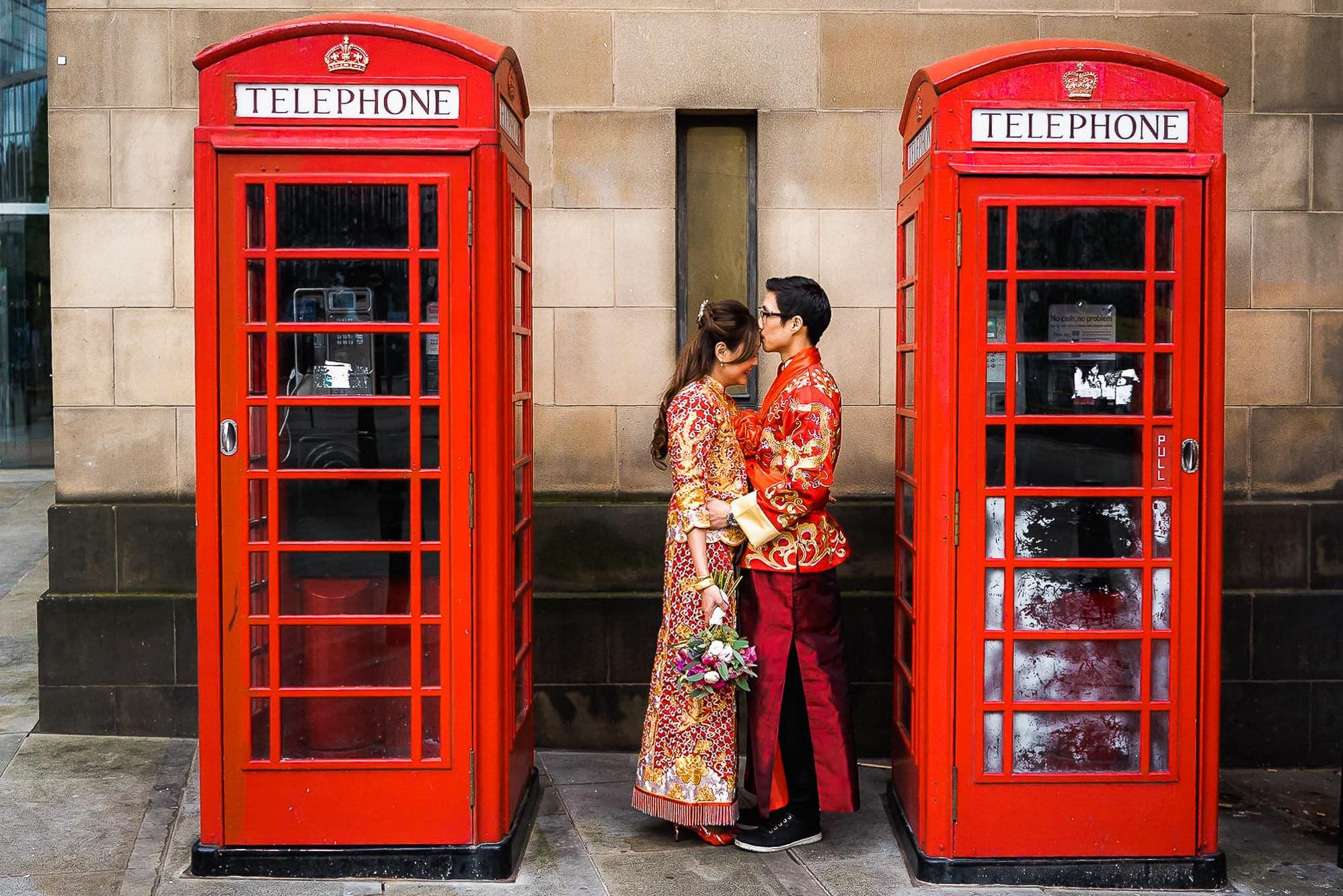 Cuddling outside phone box