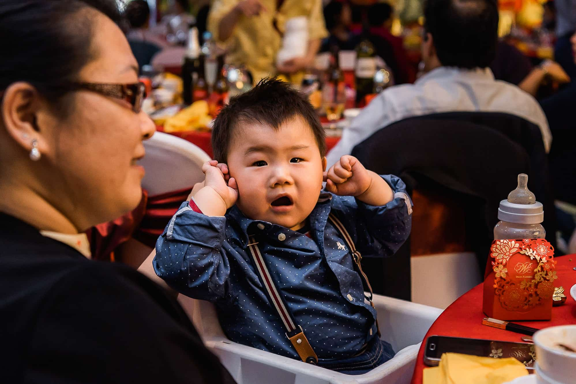 Child with hands in ears
