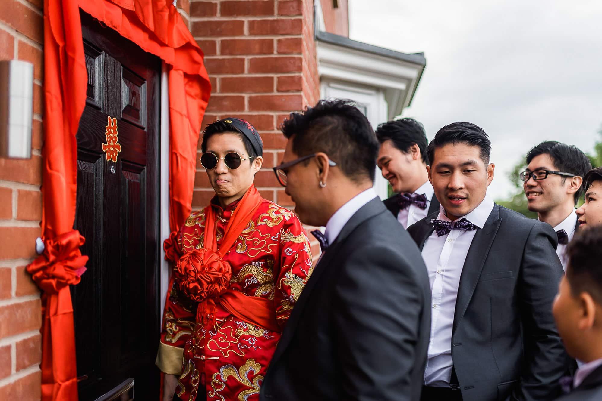 Groom waiting at the door with groomsmen