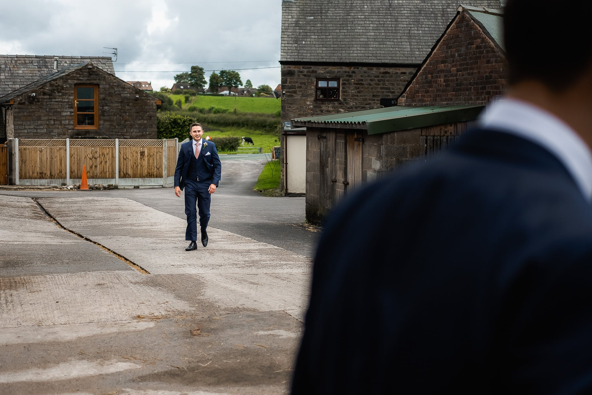 groom walking through the farm