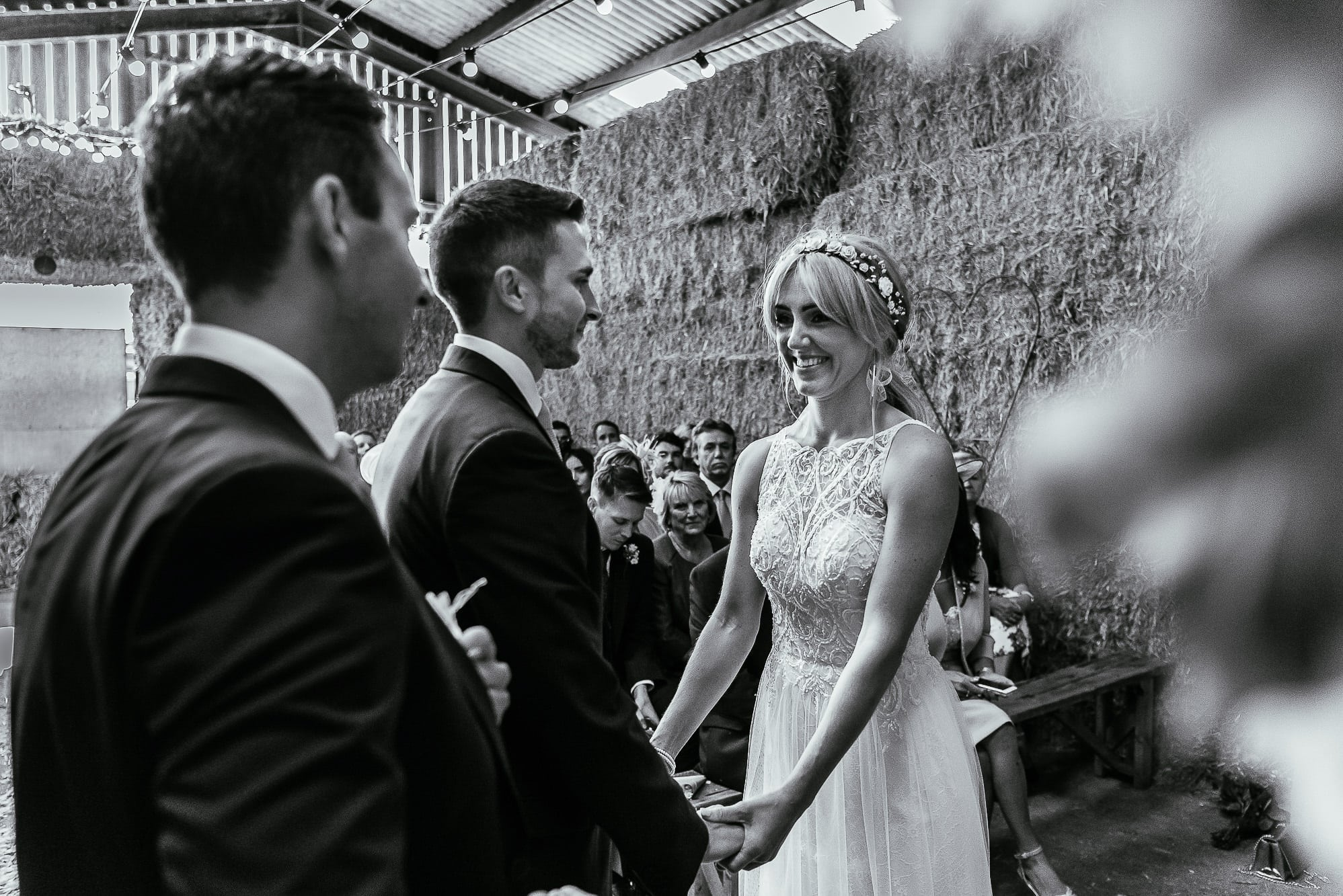 bride and groom laughing whilst saying vows