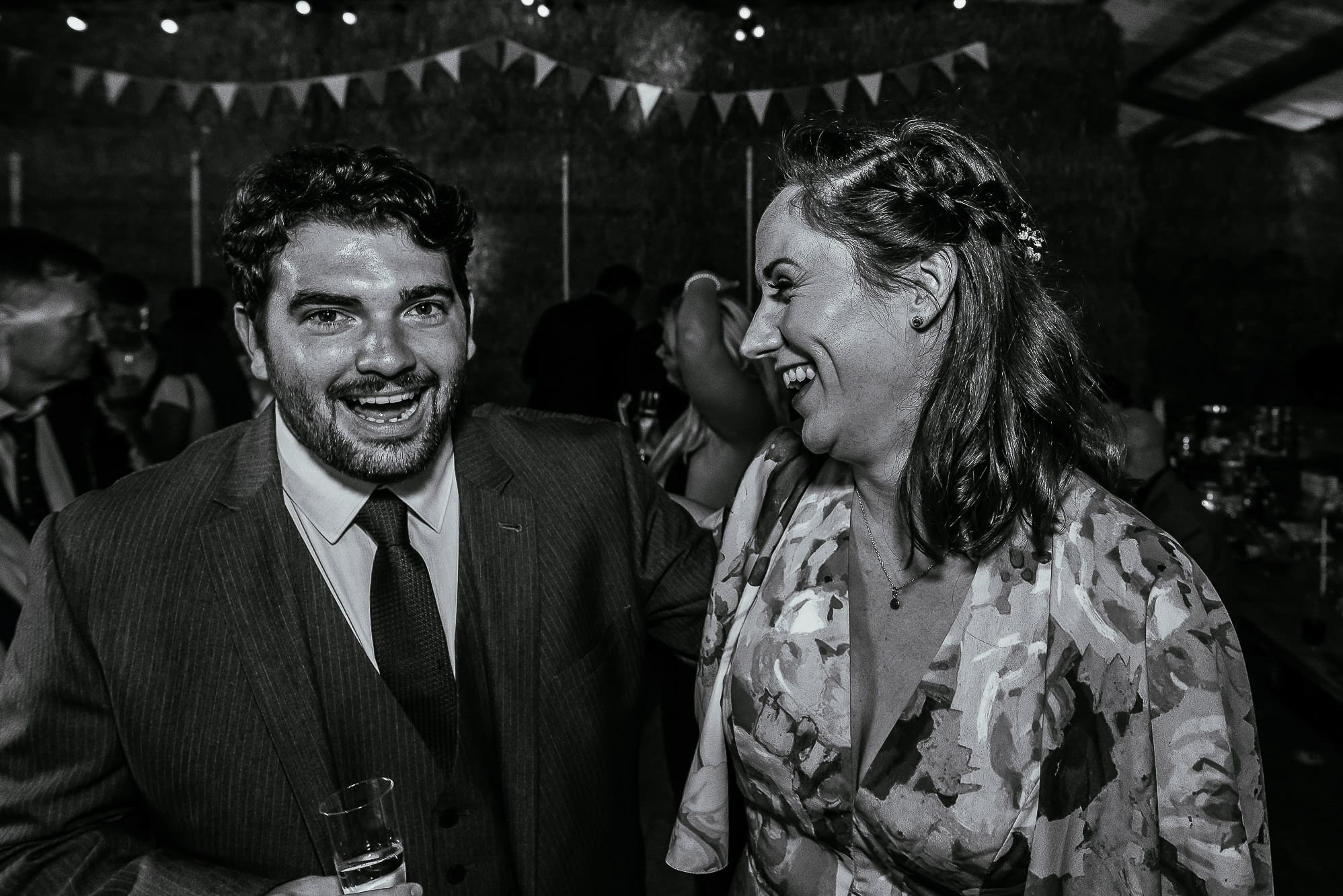 Guests laughing on dance floor