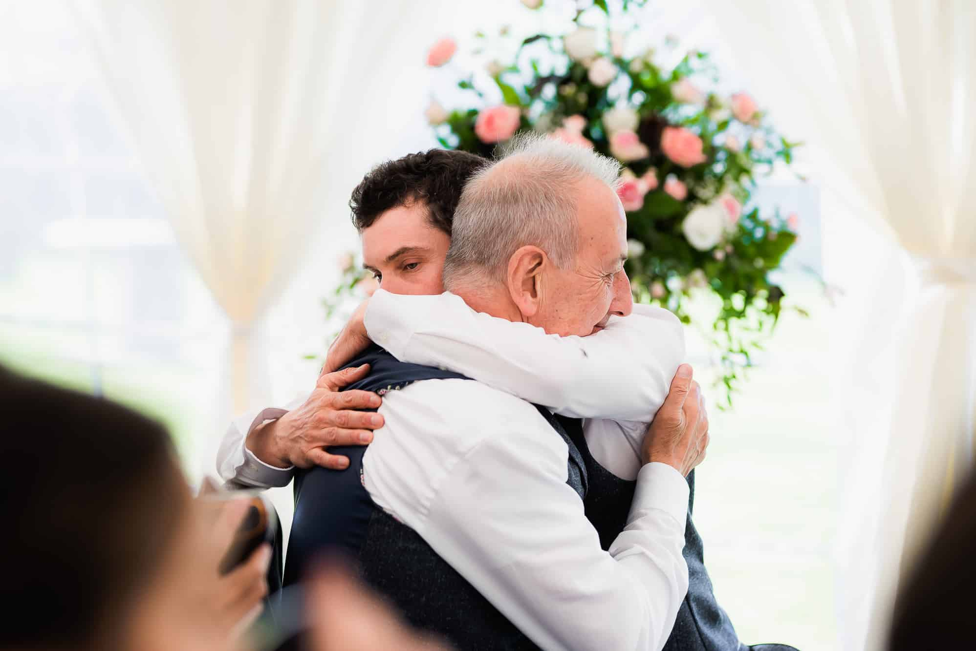Groom hugging his dad