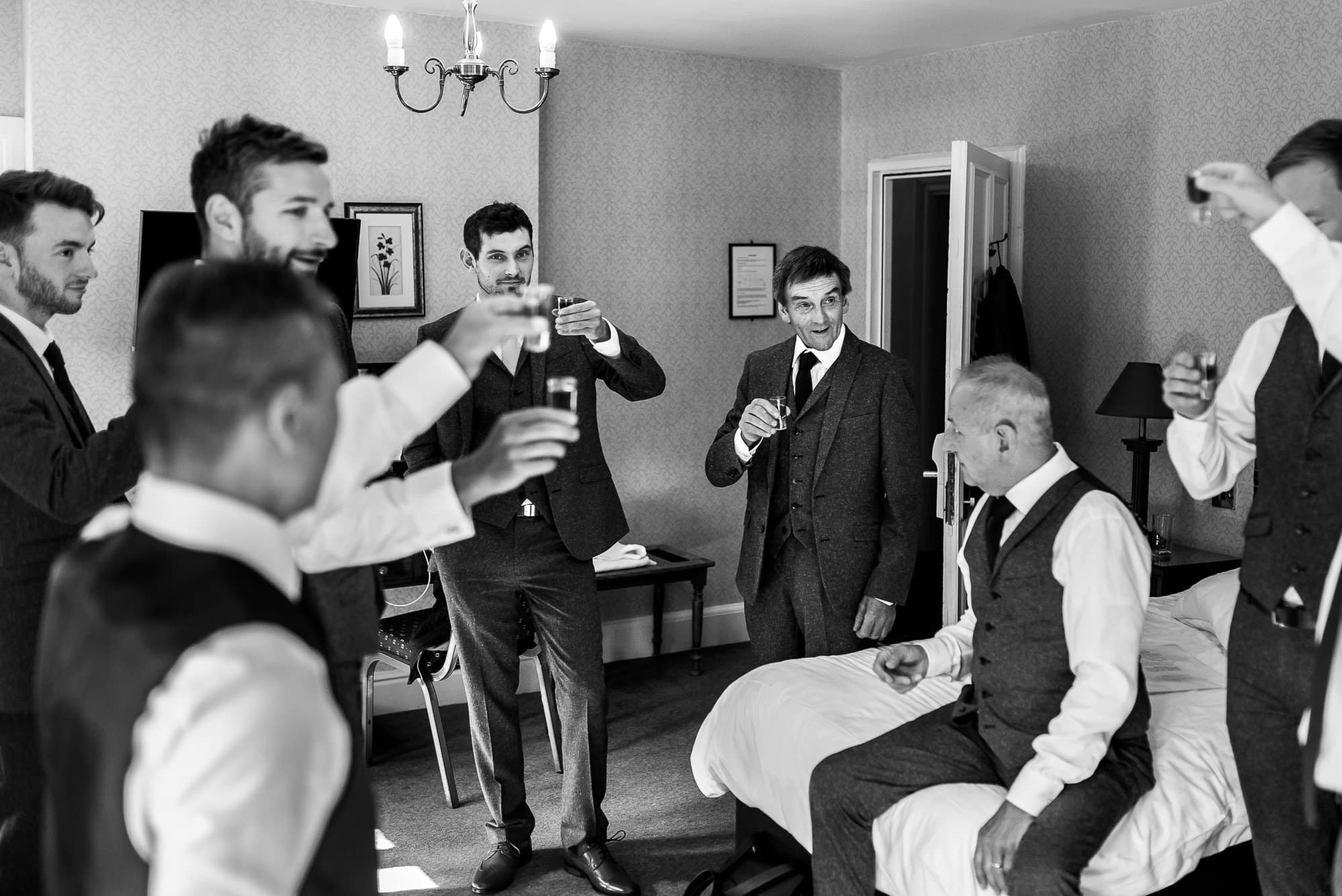 Groomsmen having a shot