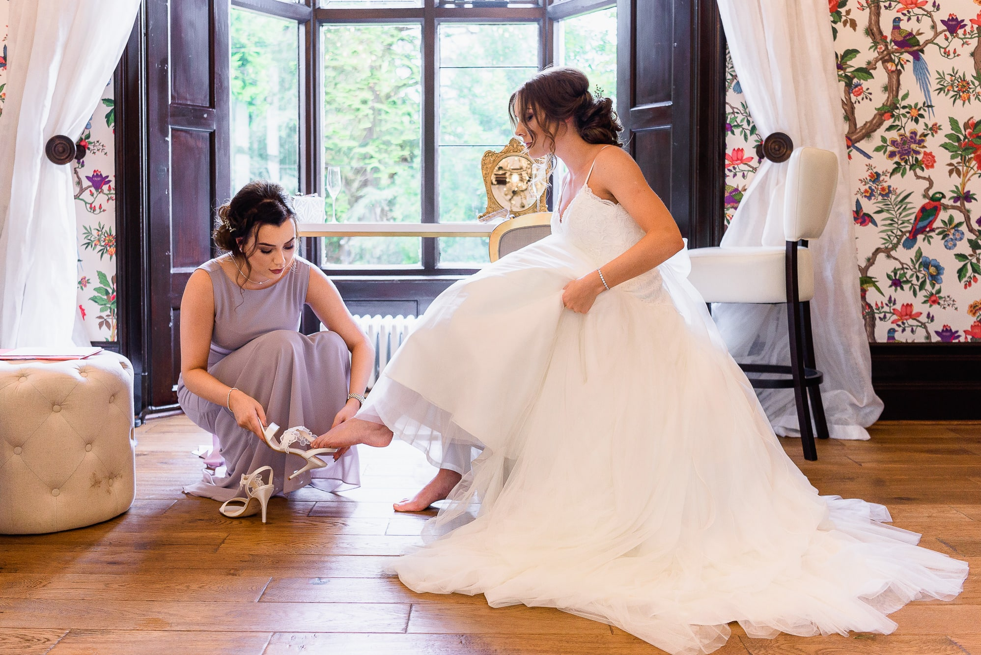 Putting on her wedding shoes