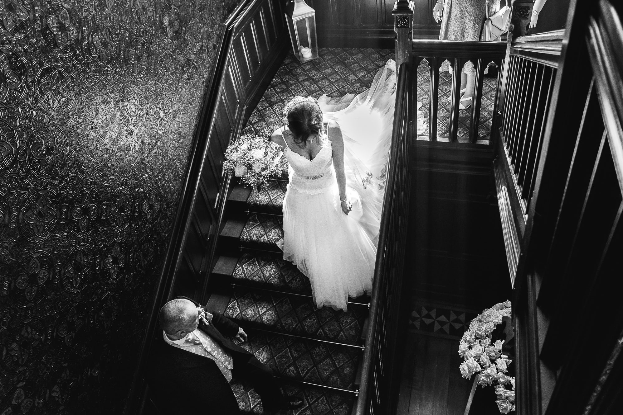 Bride walking down the stairs to get married at Tyn Dwr Hall