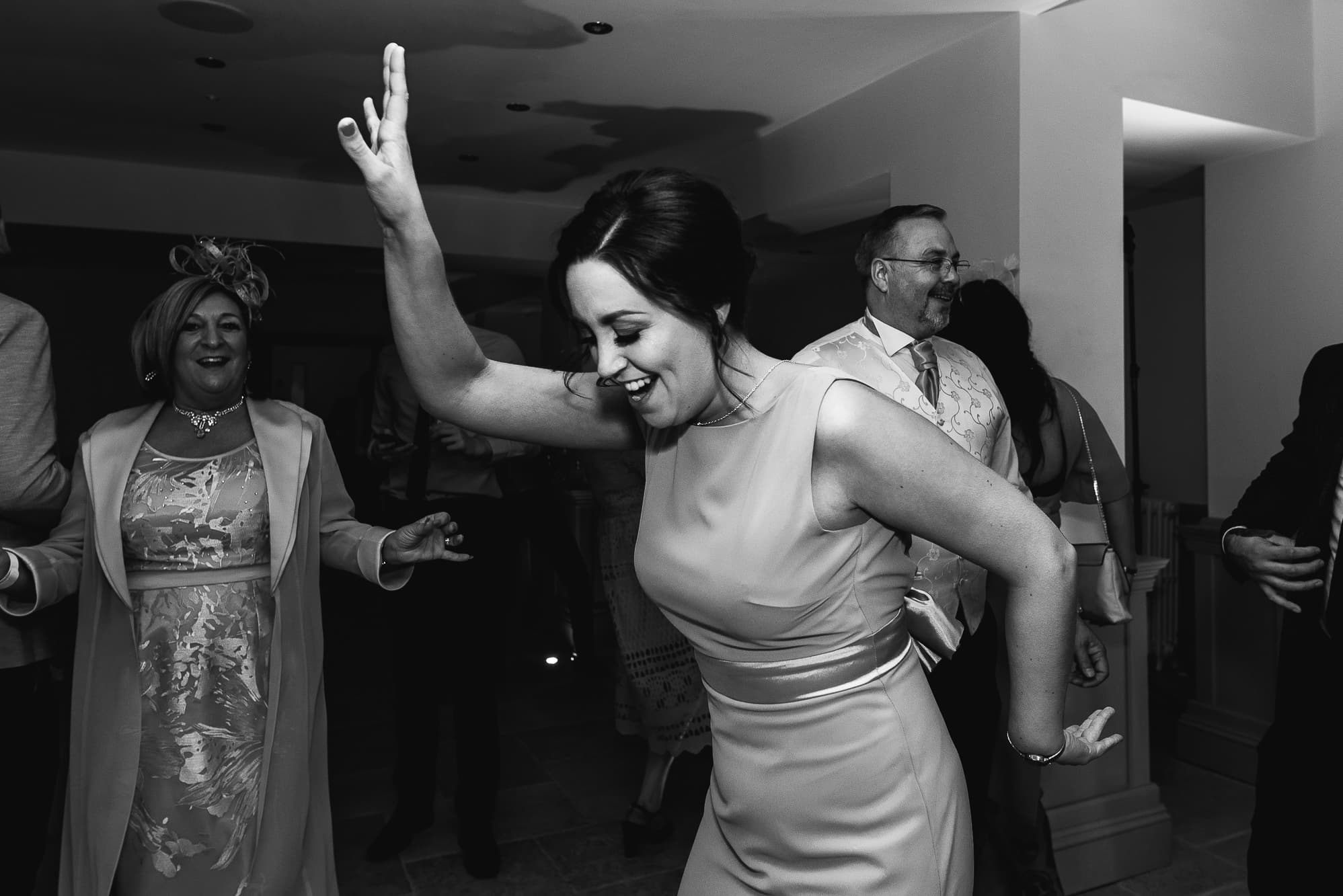 Bridesmaid dancing at Tyn Dwr Hall