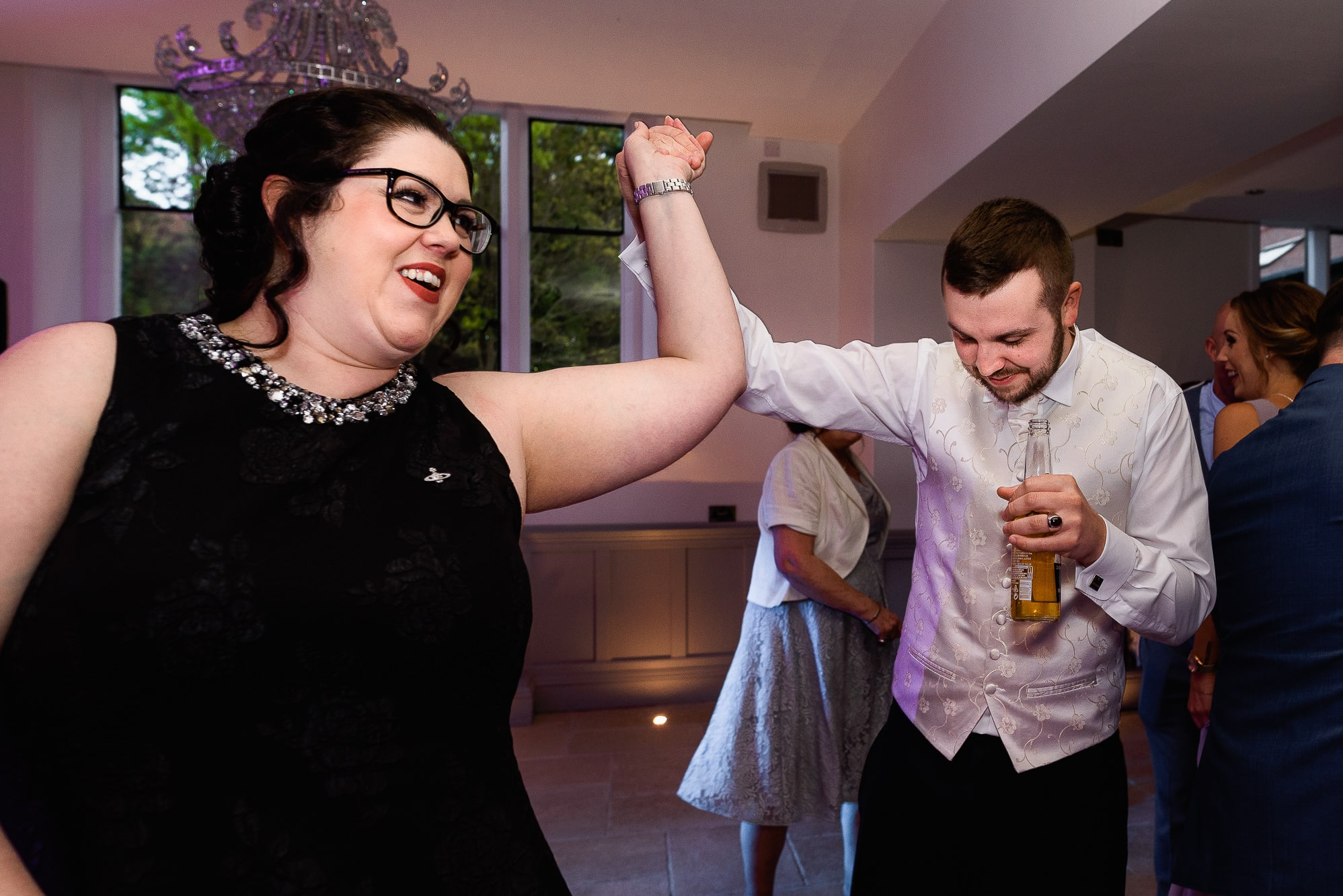 Groom and guests dancing at Tyn Dwr Hall Wedding Venue