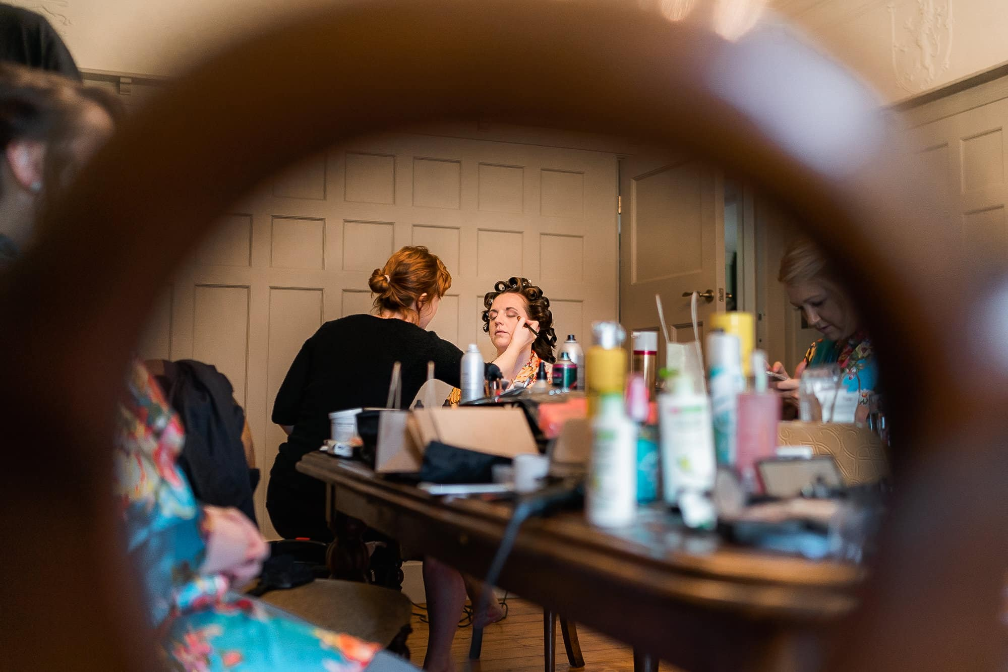 Bride having make up before her wedding at Colshaw Hall