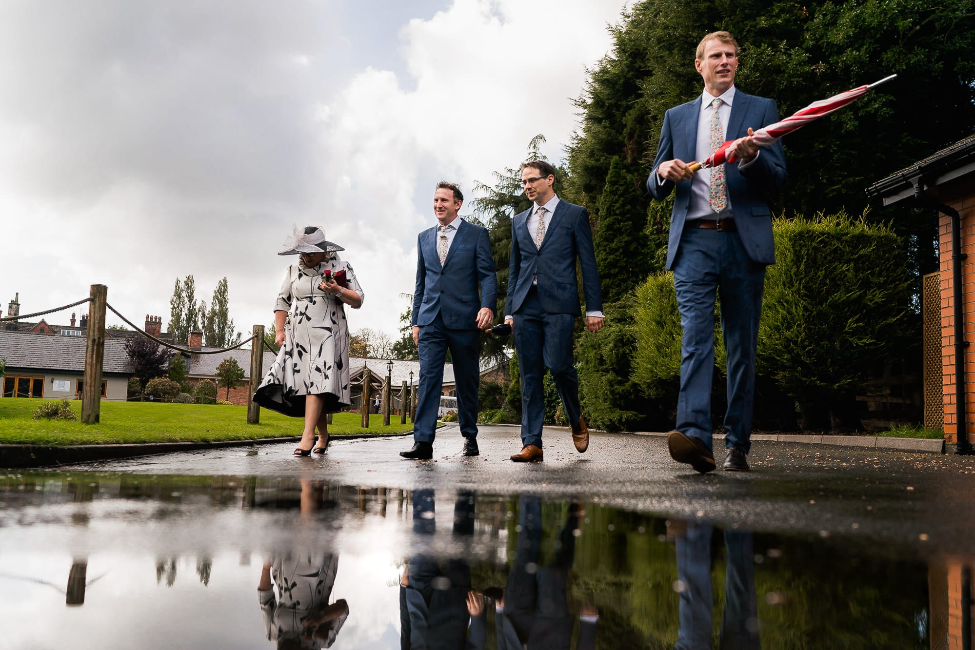 Guests walking in rain at Colshaw Hall