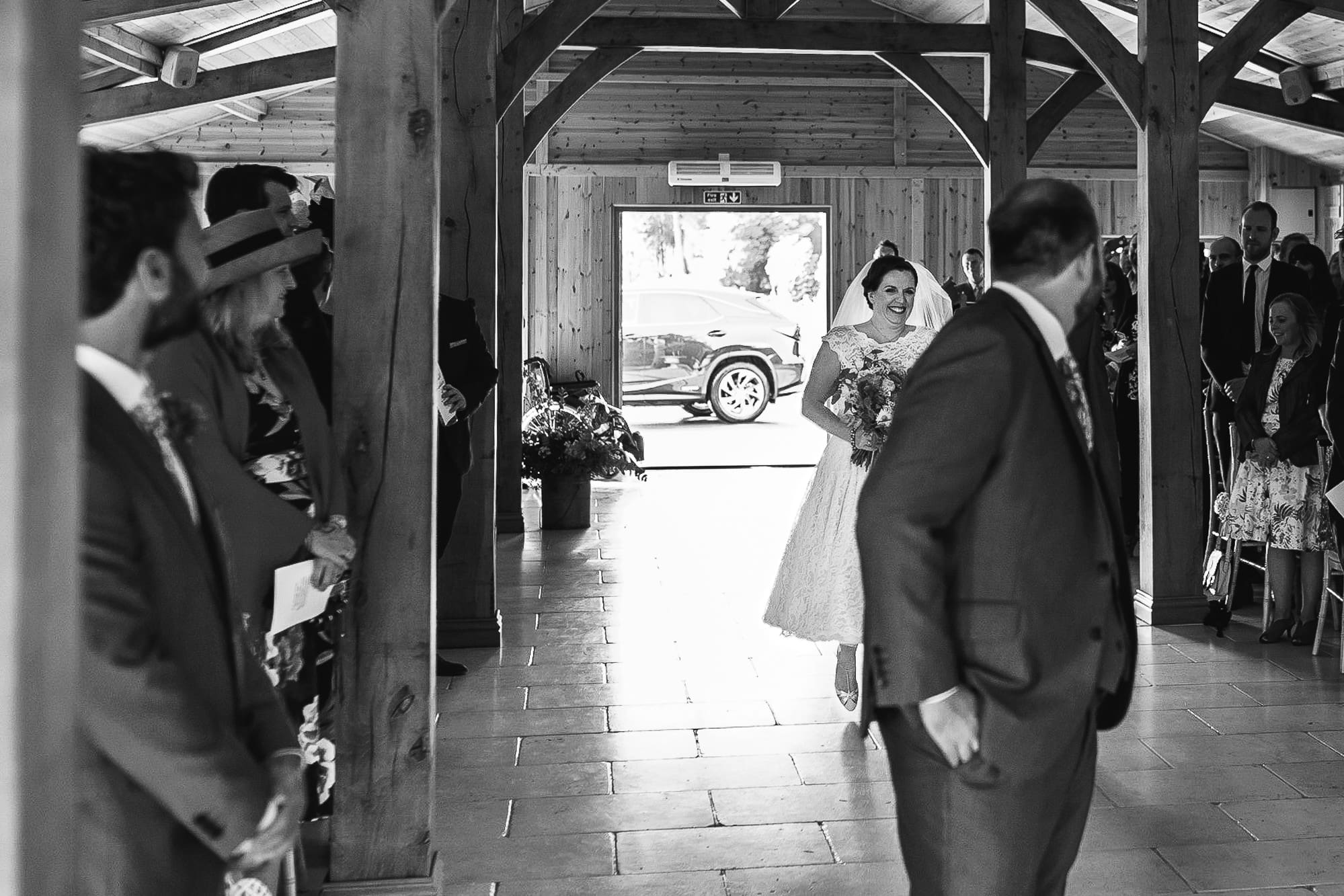 Bride walking down the aisle at Colshaw Hall