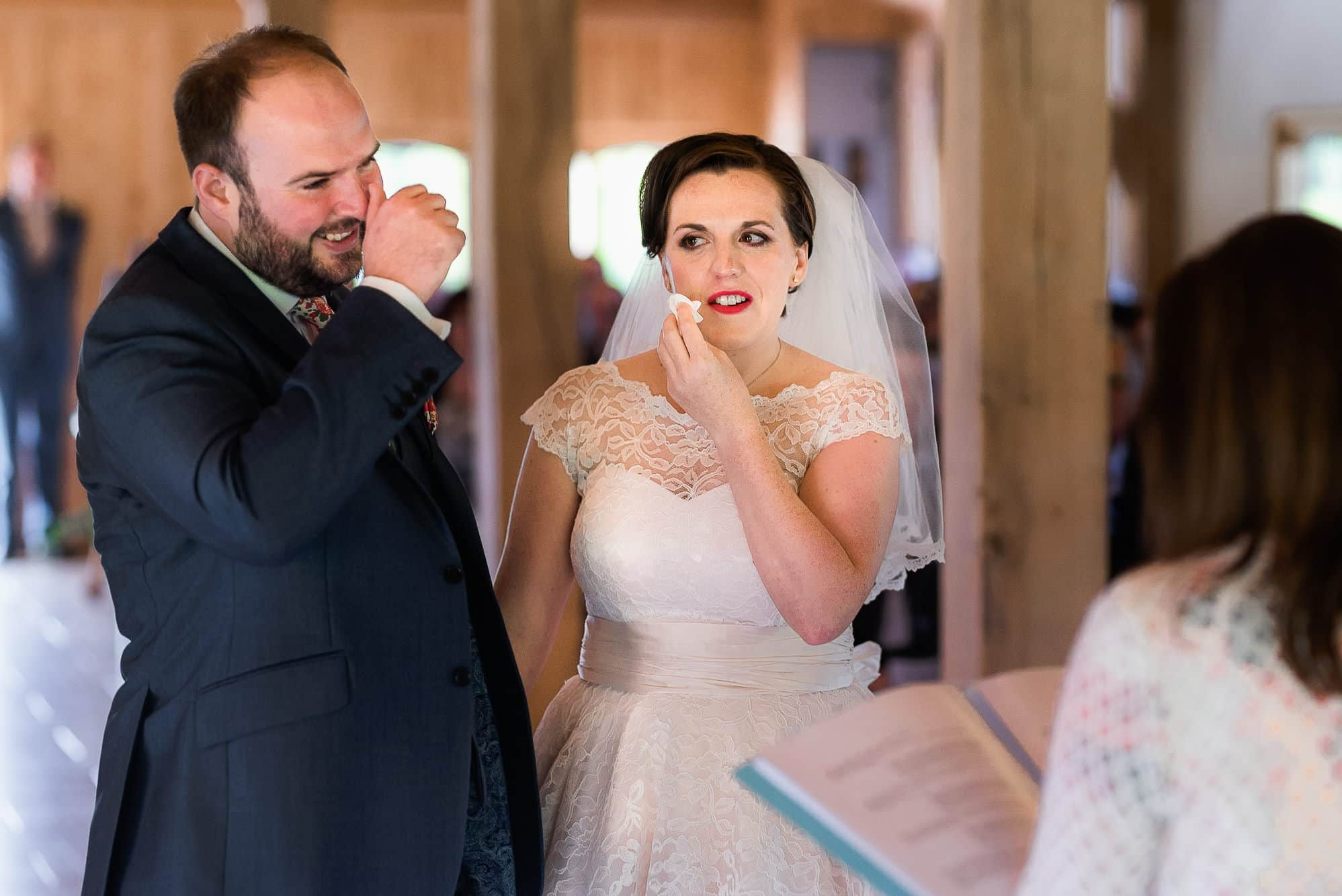 Bride and groom crying at Colshaw Hall