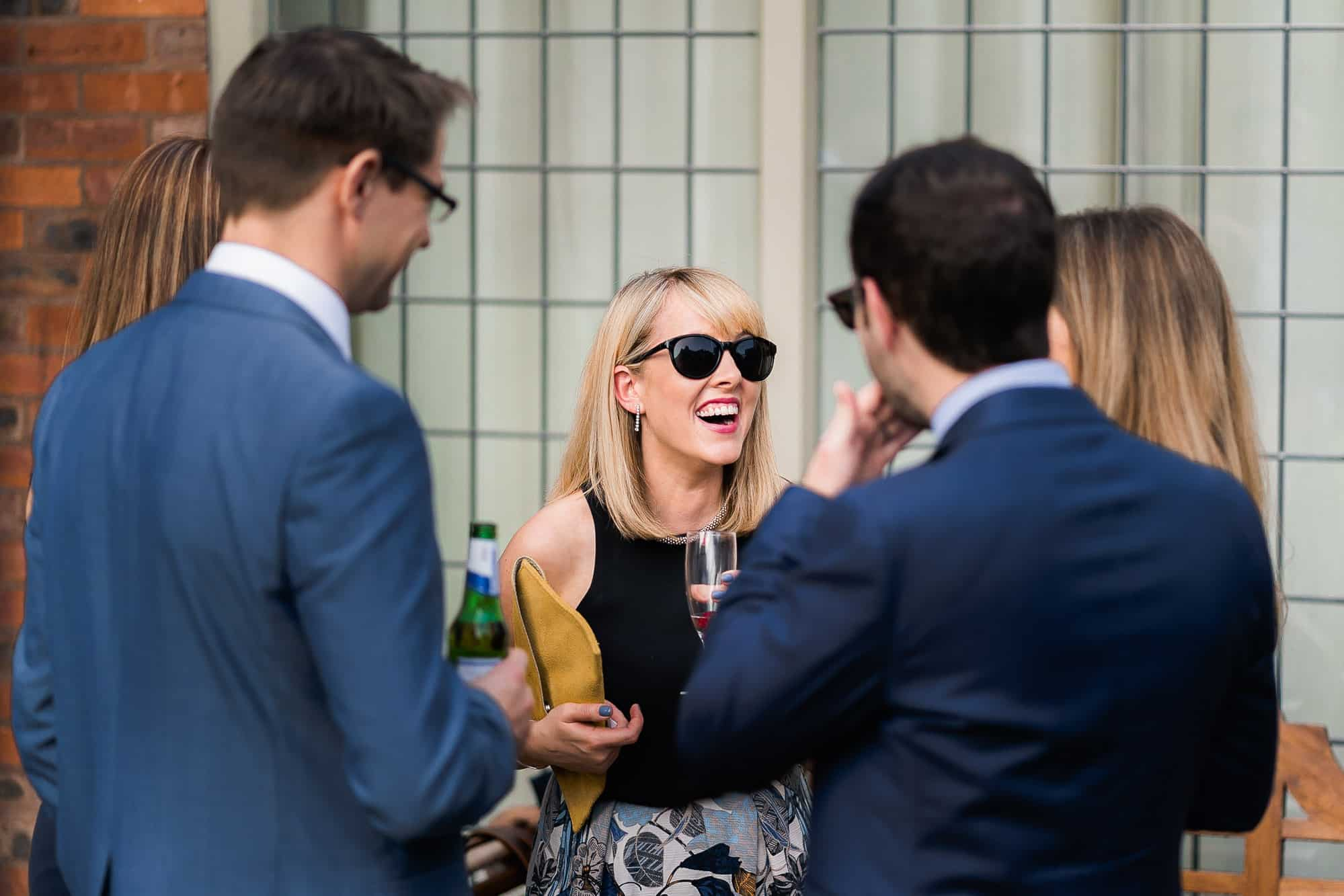 A female guest laughing at Colshaw Hall