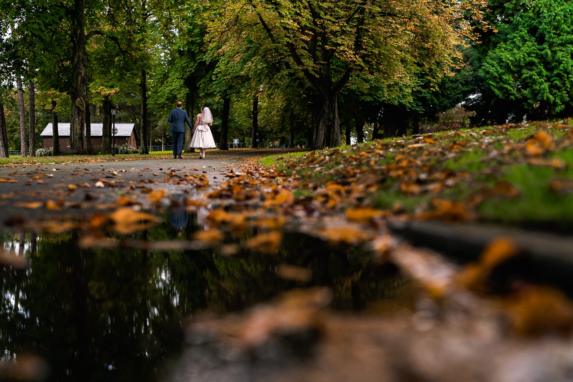 Bride and groom walking in Colshaw Hall
