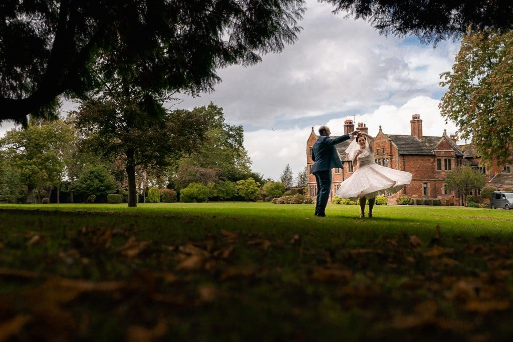 Bride and groom dancing in the grounds of Colshaw Hall