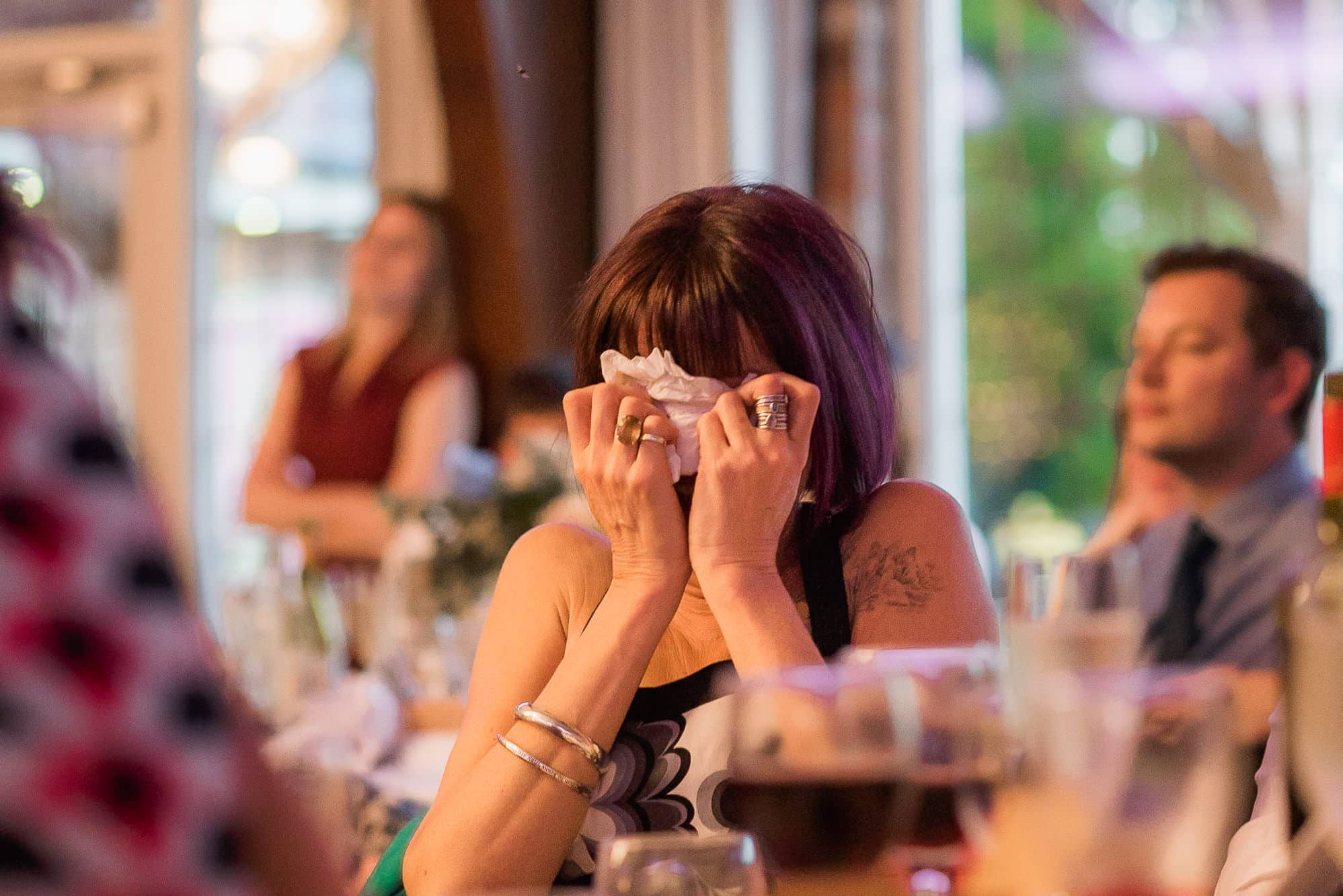 Guests hiding face during speeches at Colshaw Hall