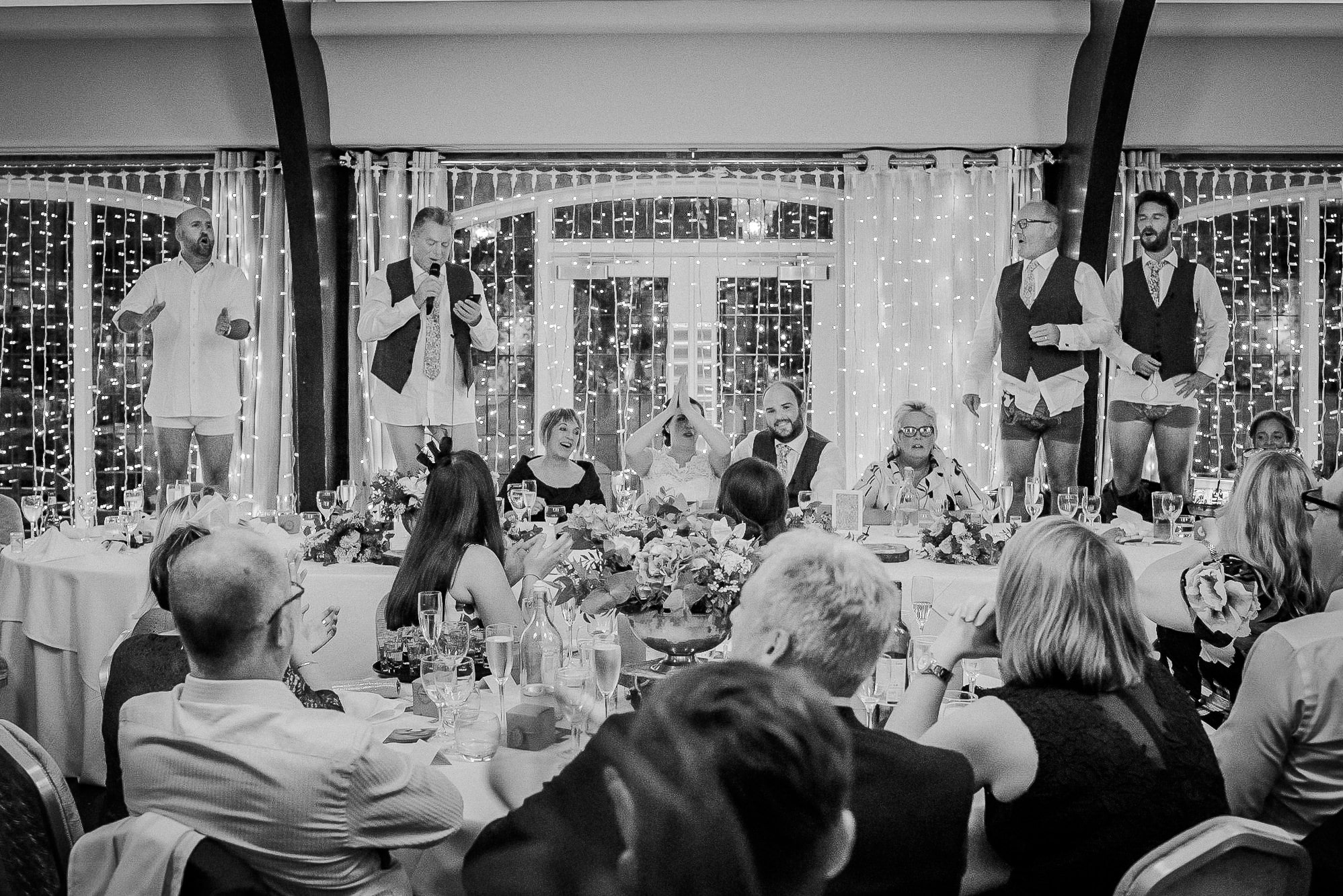 Guests standing on chairs at Colshaw Hall