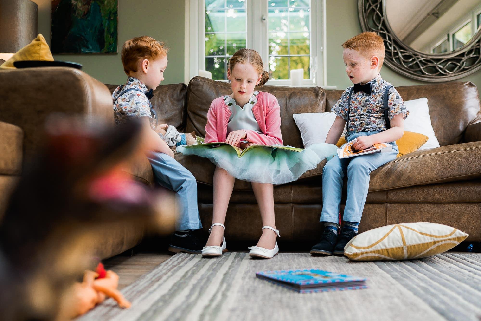 Kids talking on sofa